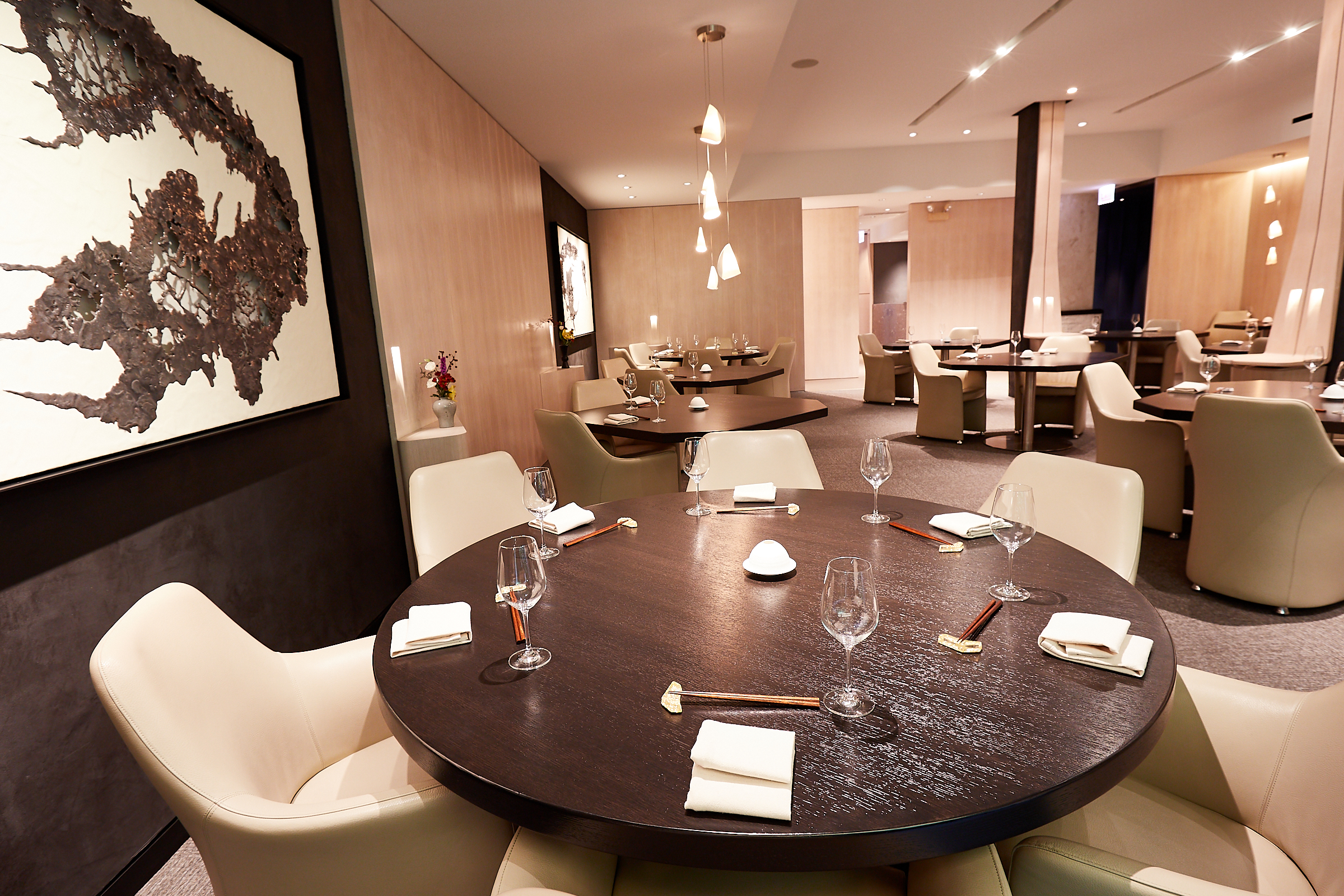 A fancy black-and-white restaurant dining room