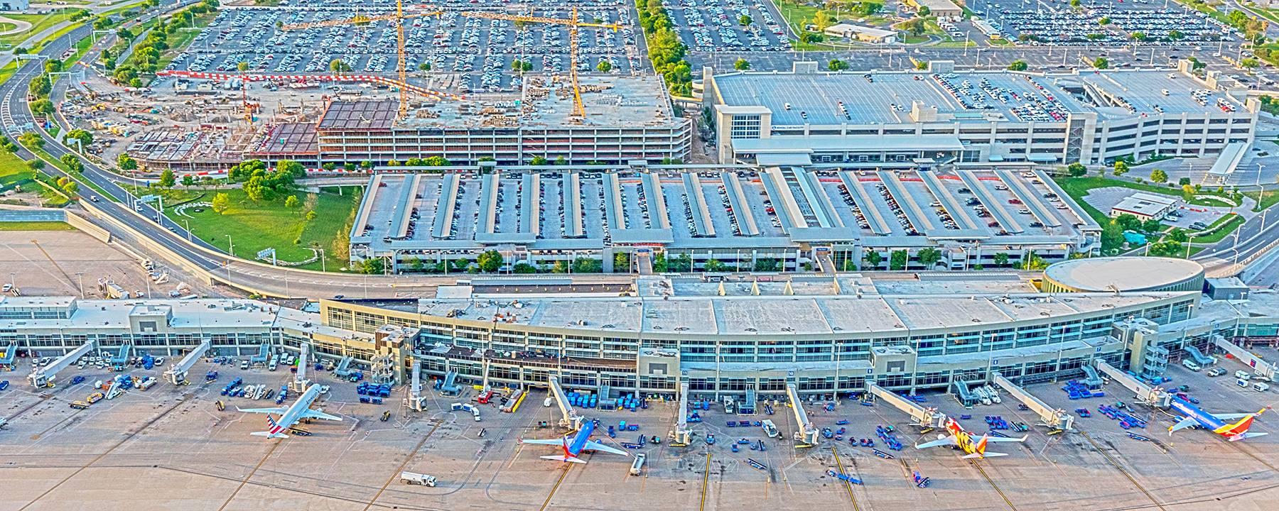 Overhead of airport plane docks, roof, parking