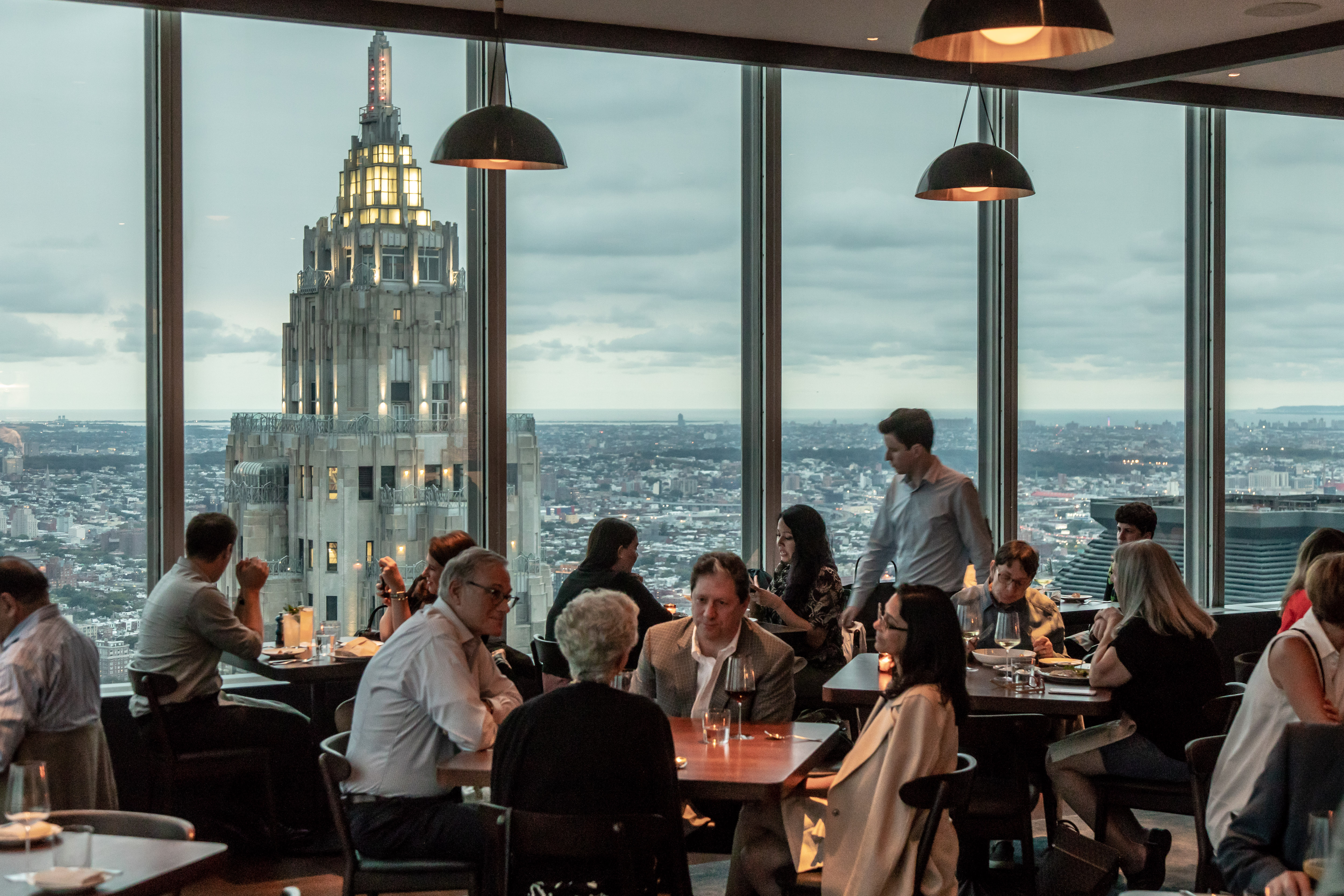 Patrons dine in view of the Art Deco 70 Pine