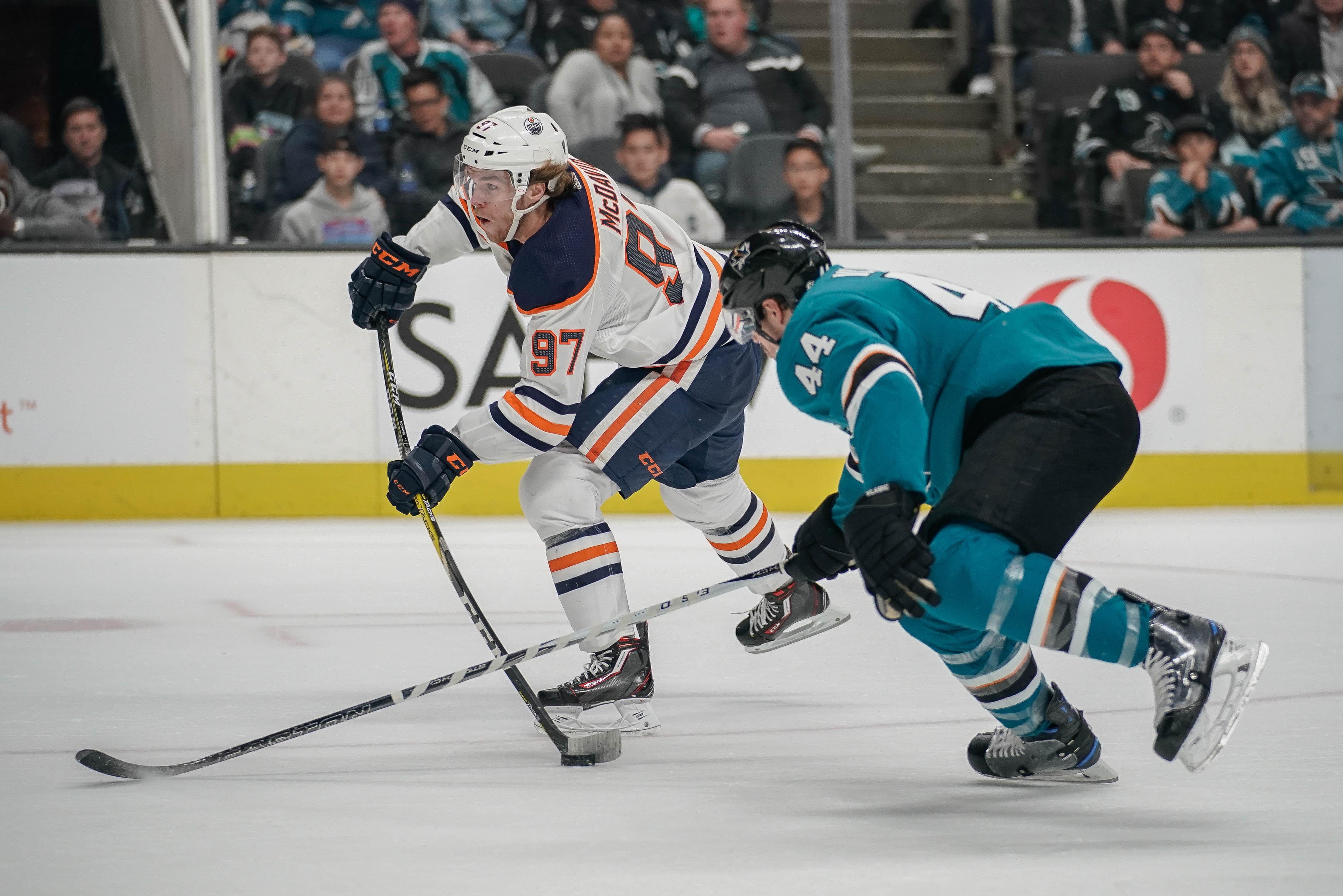 Nov 20, 2018; San Jose, CA, USA; Edmonton Oilers center Connor McDavid (97) controls the puck against San Jose Sharks defenseman Marc-Edouard Vlasic (44) during the first period at SAP Center at San Jose. Mandatory Credit: Stan Szeto