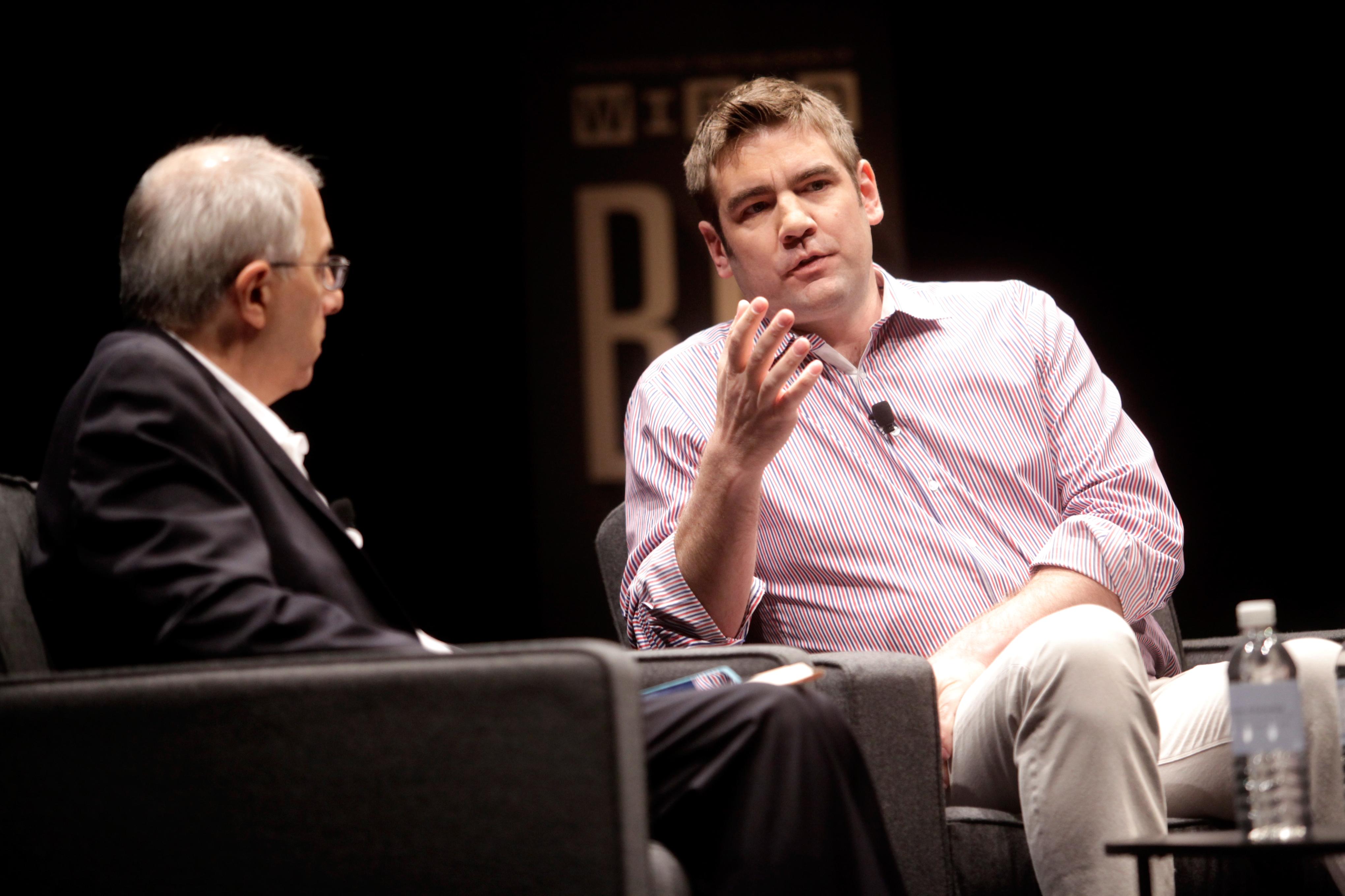 Andreessen Horowitz partner Chris Dixon, right, onstage with Steven Levy, left