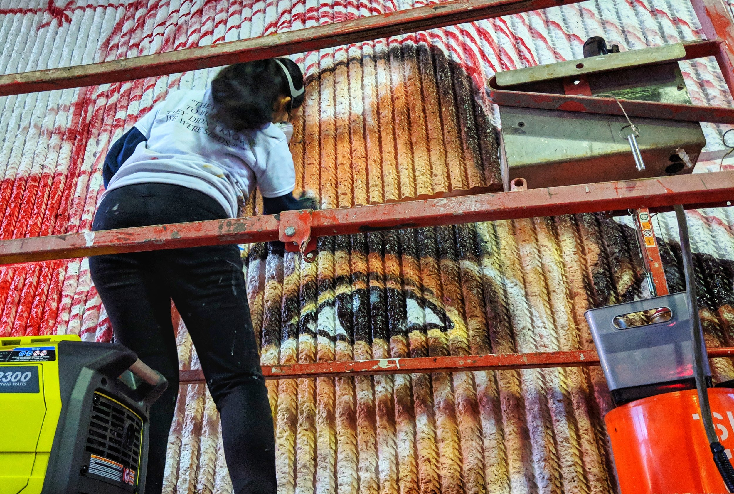 A picture of an artist creating a mural