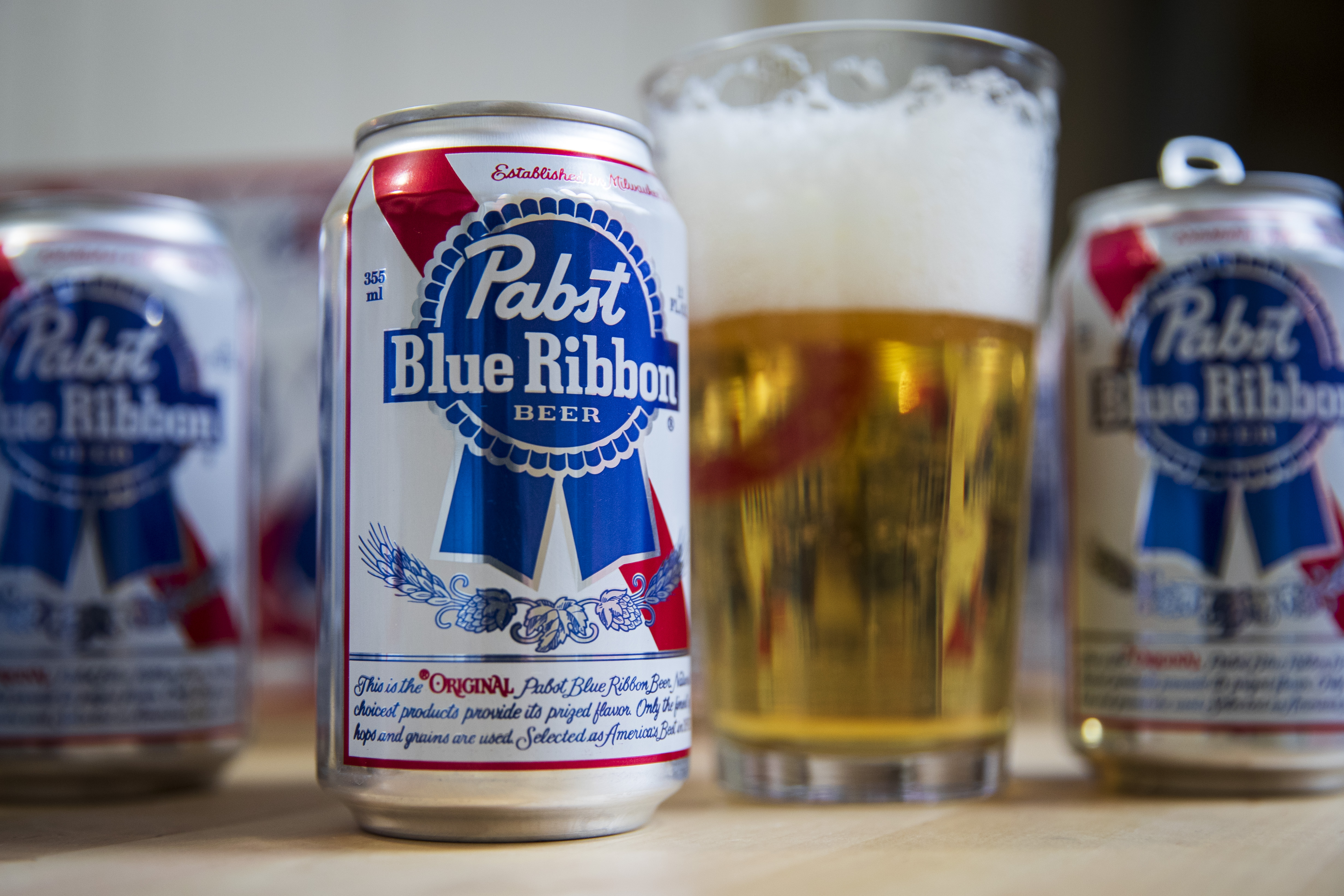 A PBR Can and beer in a pint glass