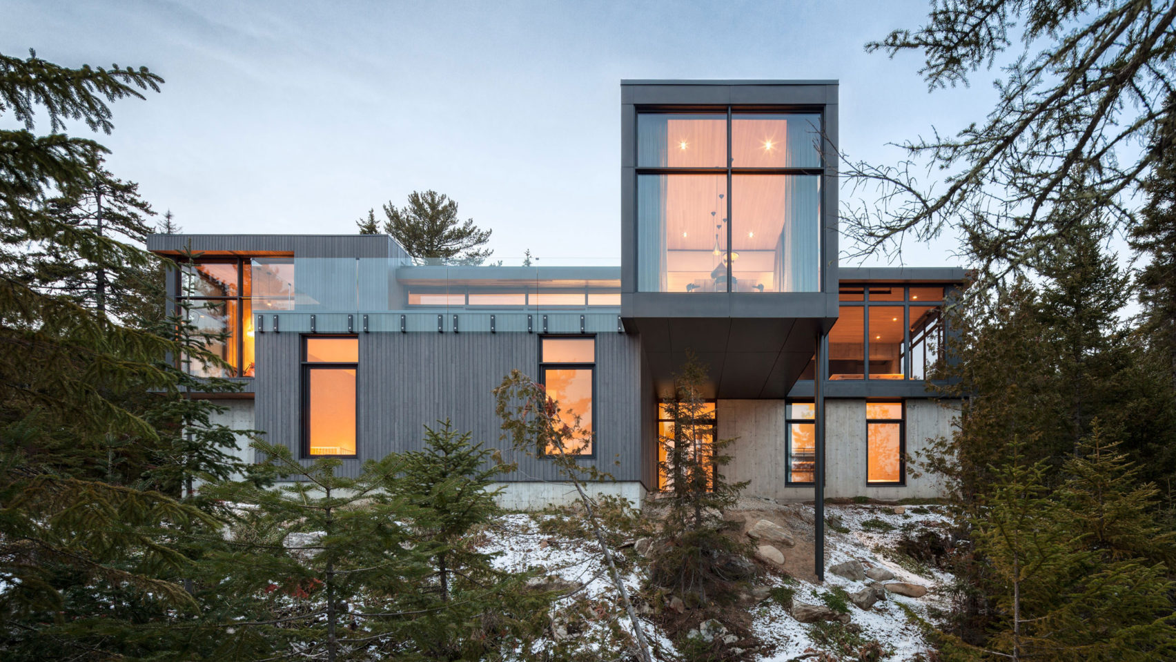 Gray house surrounded by woods
