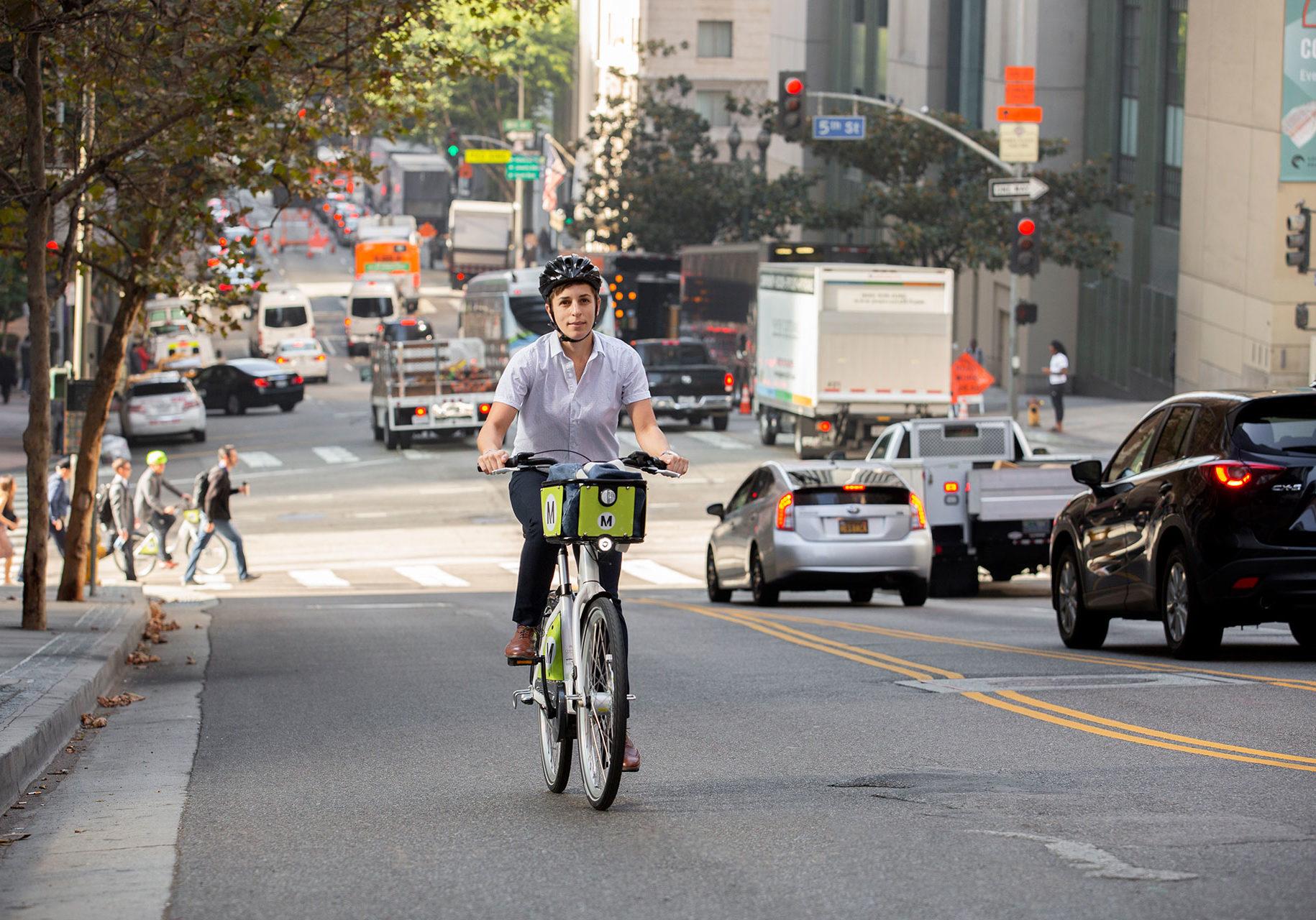 person riding an e-bike uphill