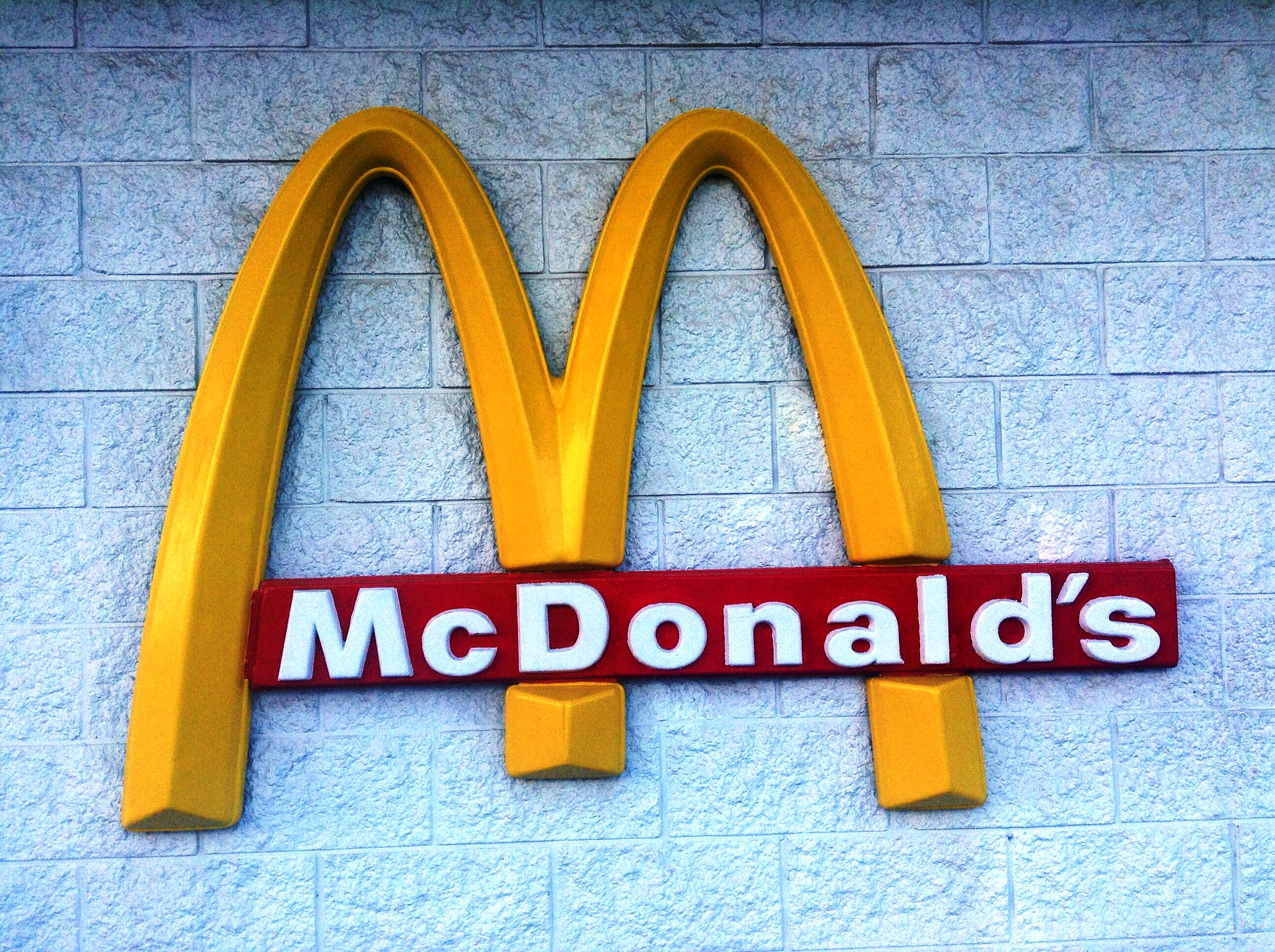 The McDonald's golden arches on the side of a building.