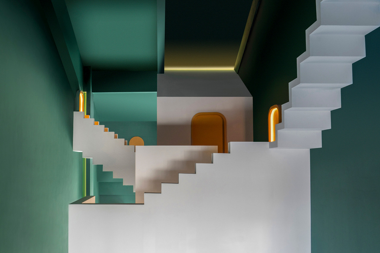 White floating staircases and green walls