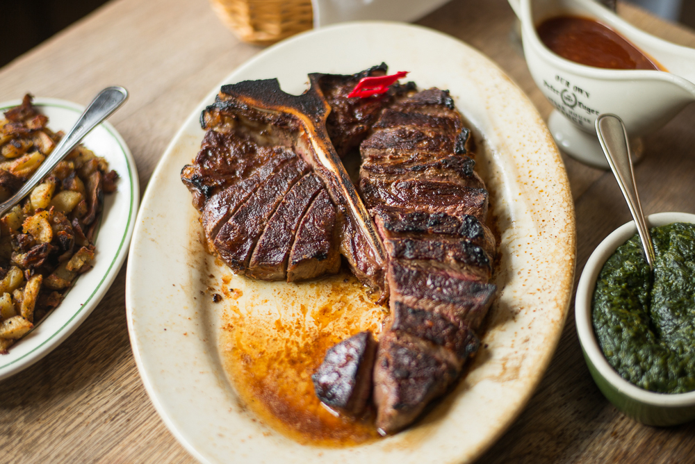 Peter Luger porterhouse on a white plate