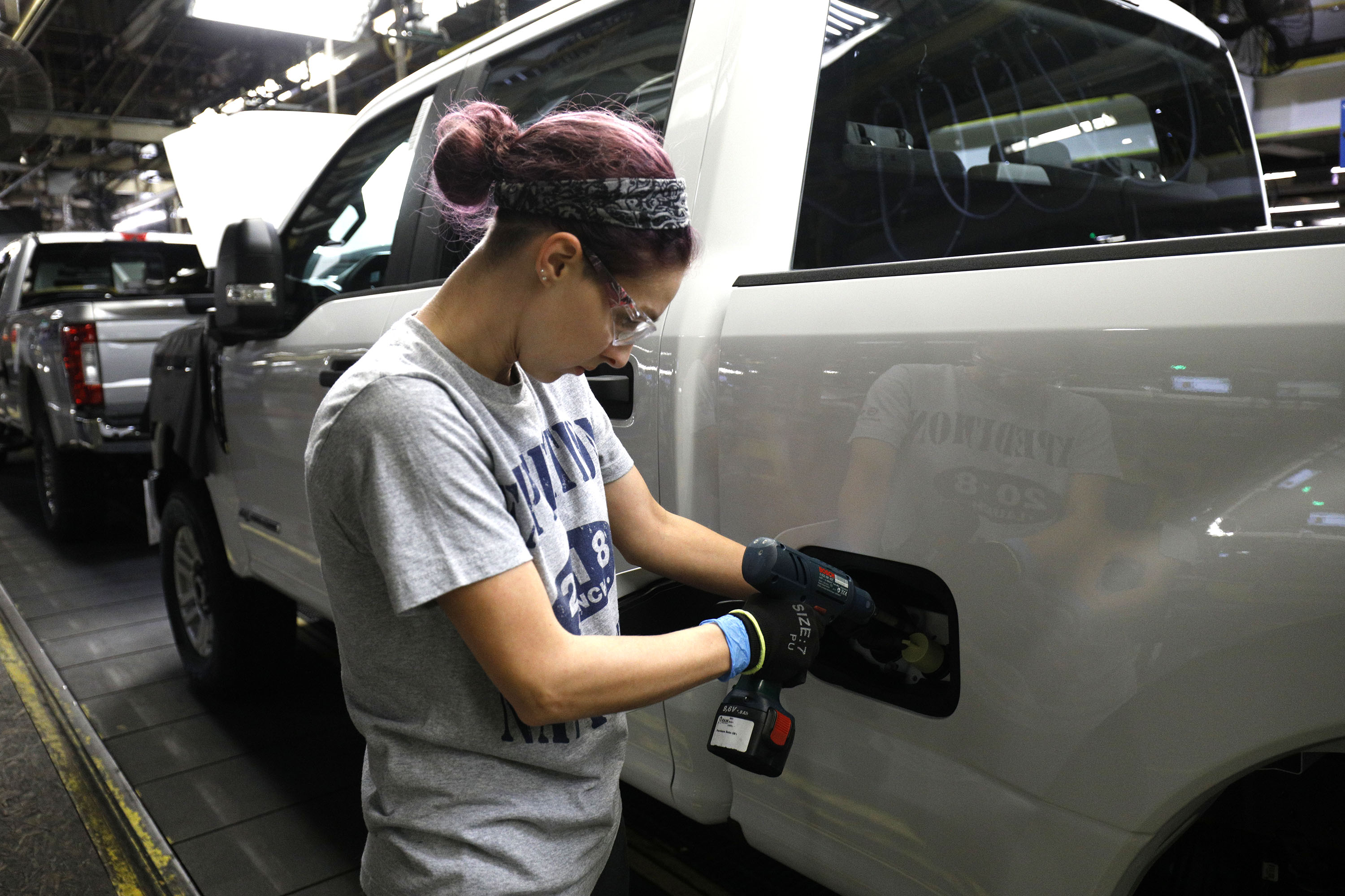 A worker builds a Ford F-250 as it goes through the assembly line at the Ford Kentucky Truck Plant on October 27, 2017 in Louisville, Kentucky.