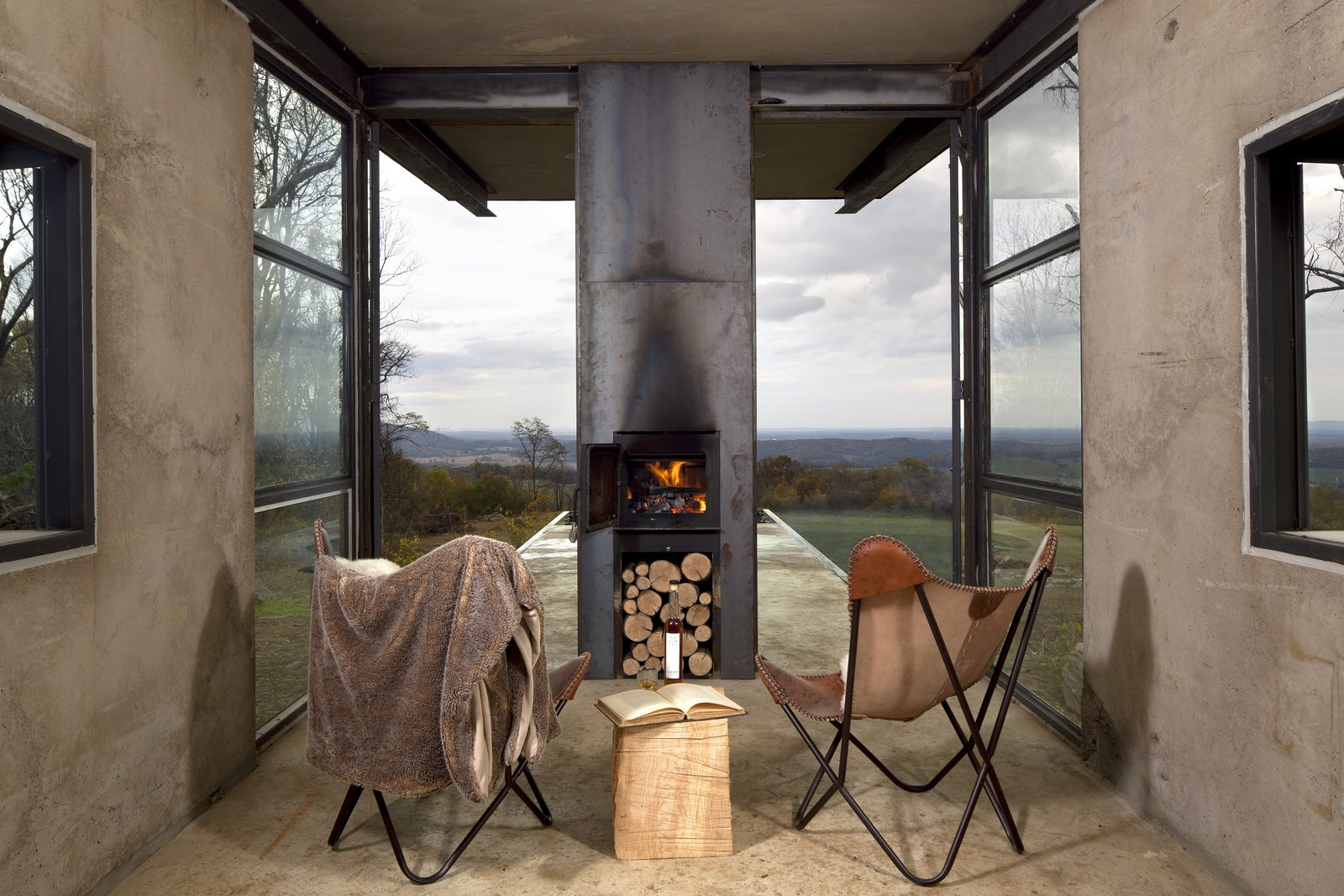 Chairs facing wood burning stove and windows