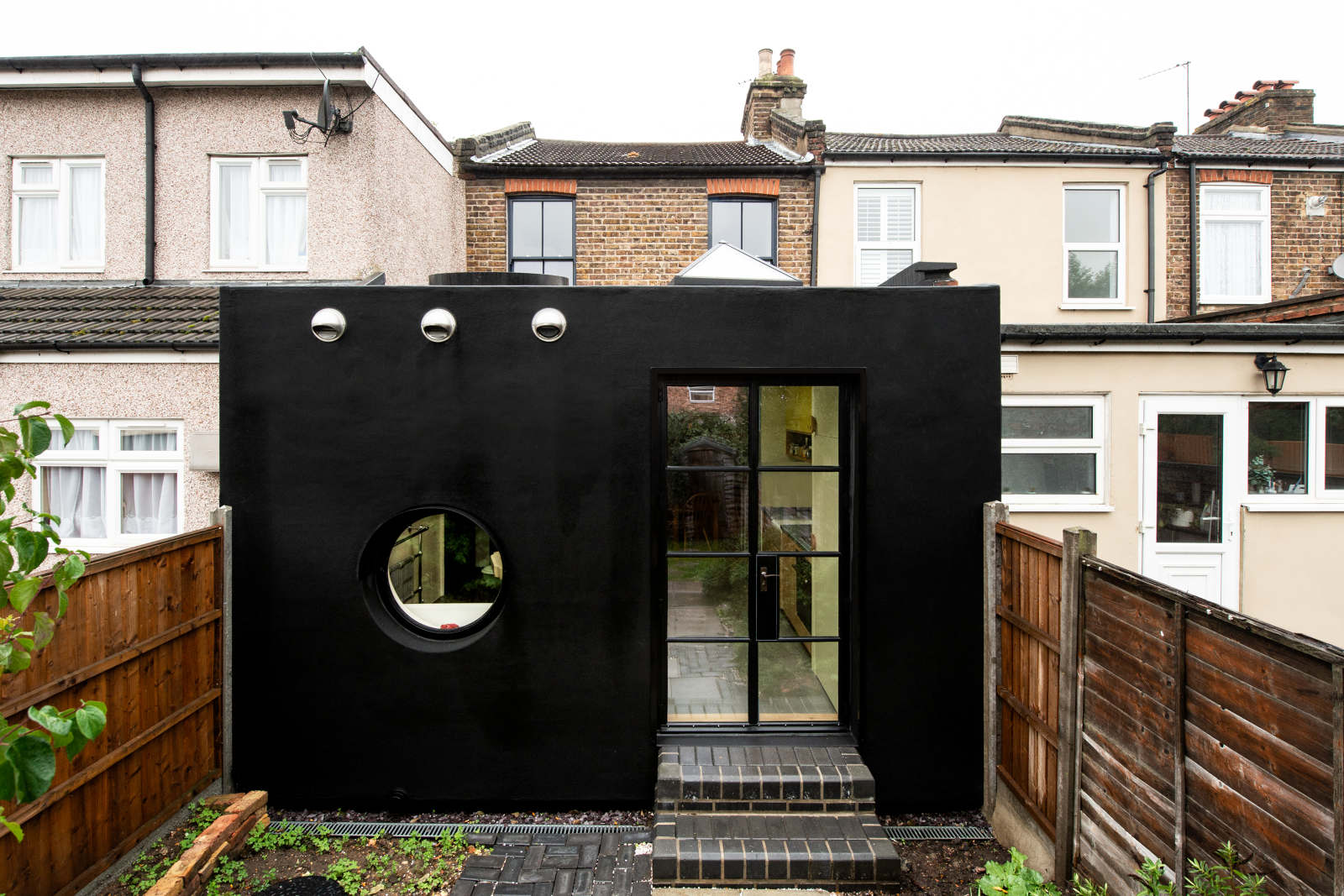 All-black home addition hides playful shapes and colors