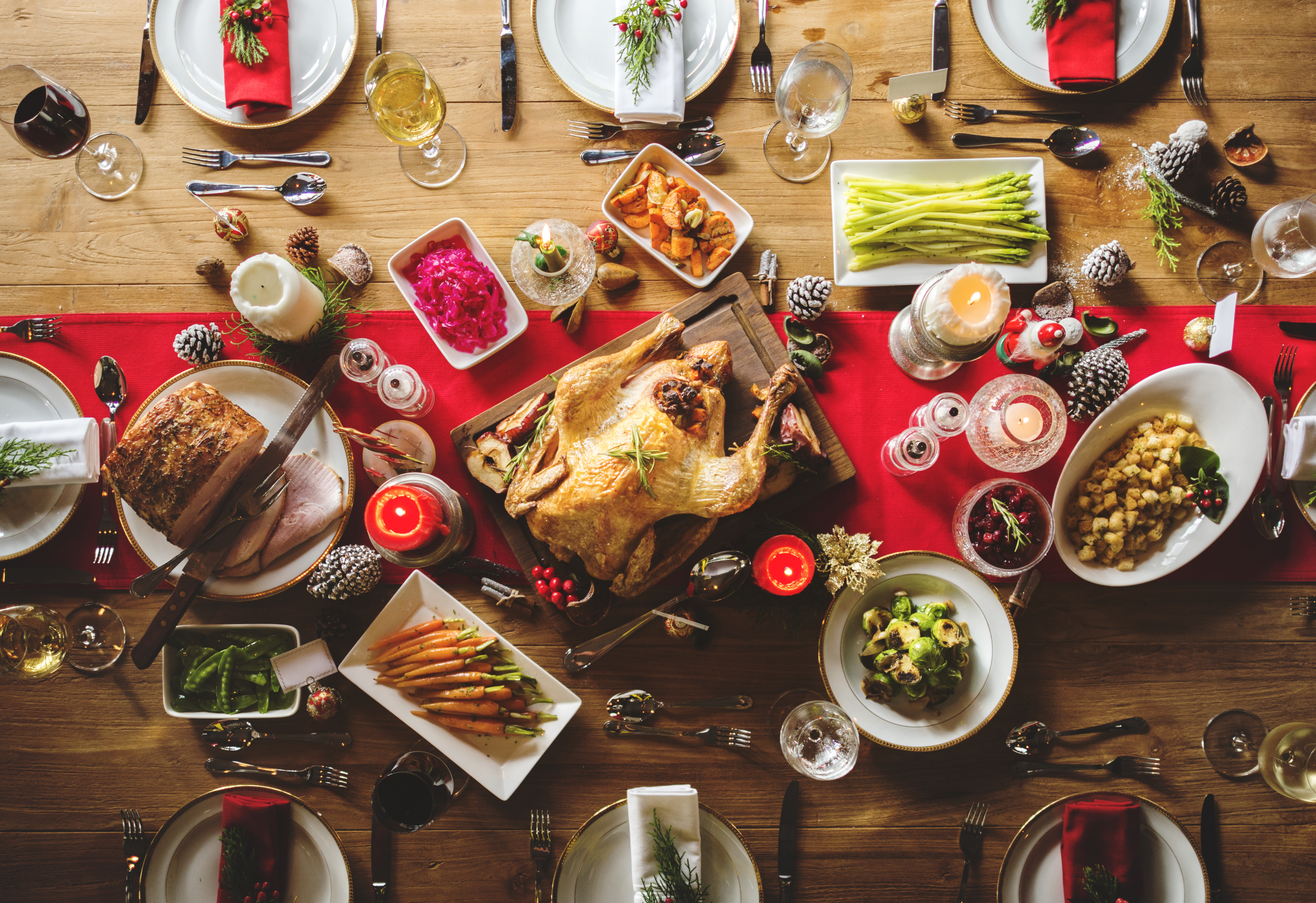 A stock photo that shows an overhead view of a festive table set for a holiday meal