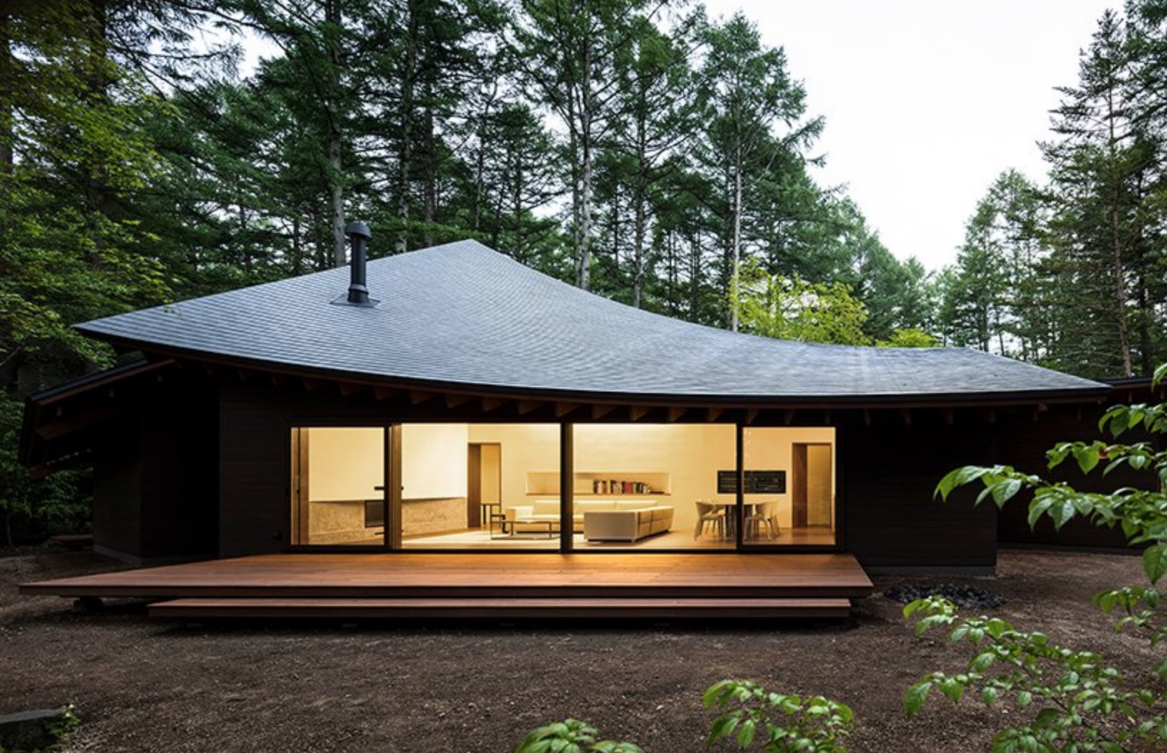 Modern Japanese house in the woods looks like fallen leaves