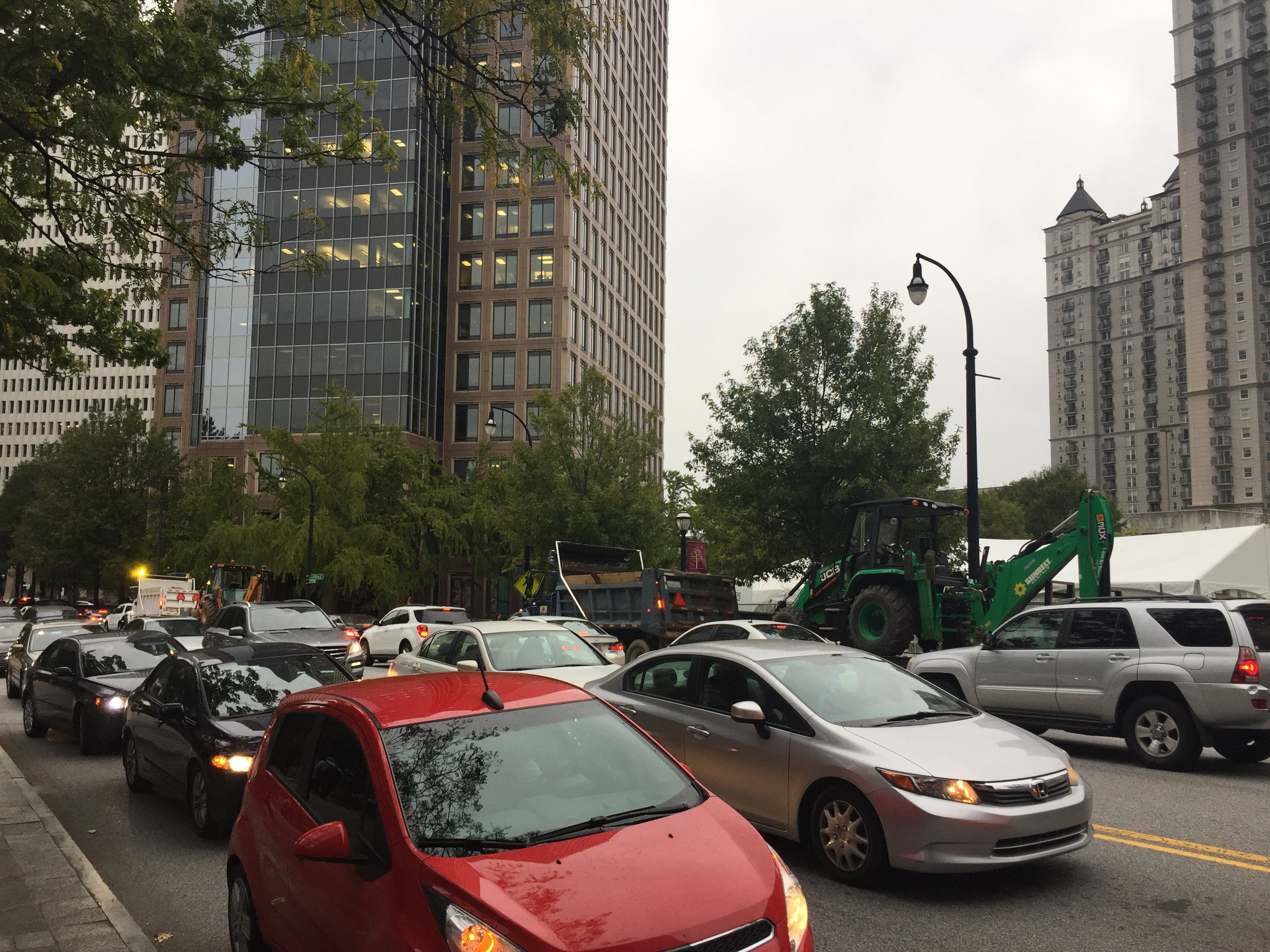 Traffic stopped in both directions on a packed city street.