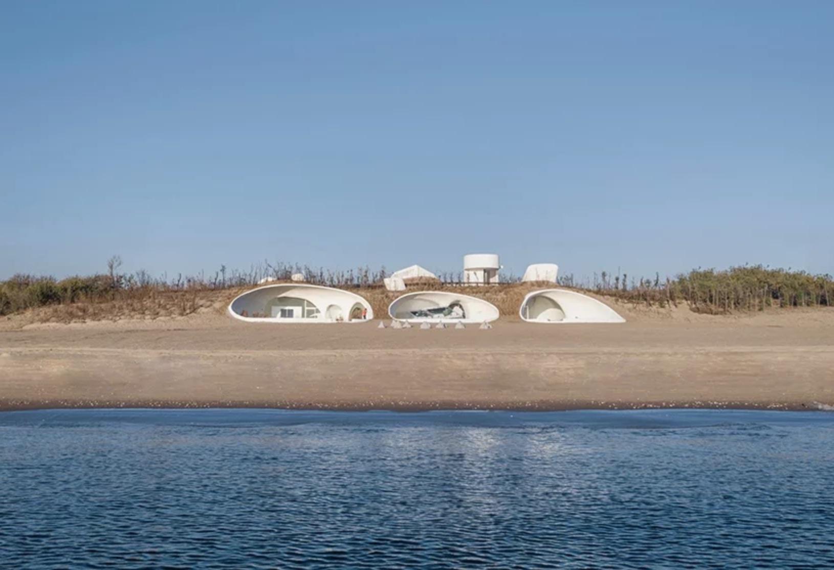 Building set into sand dune