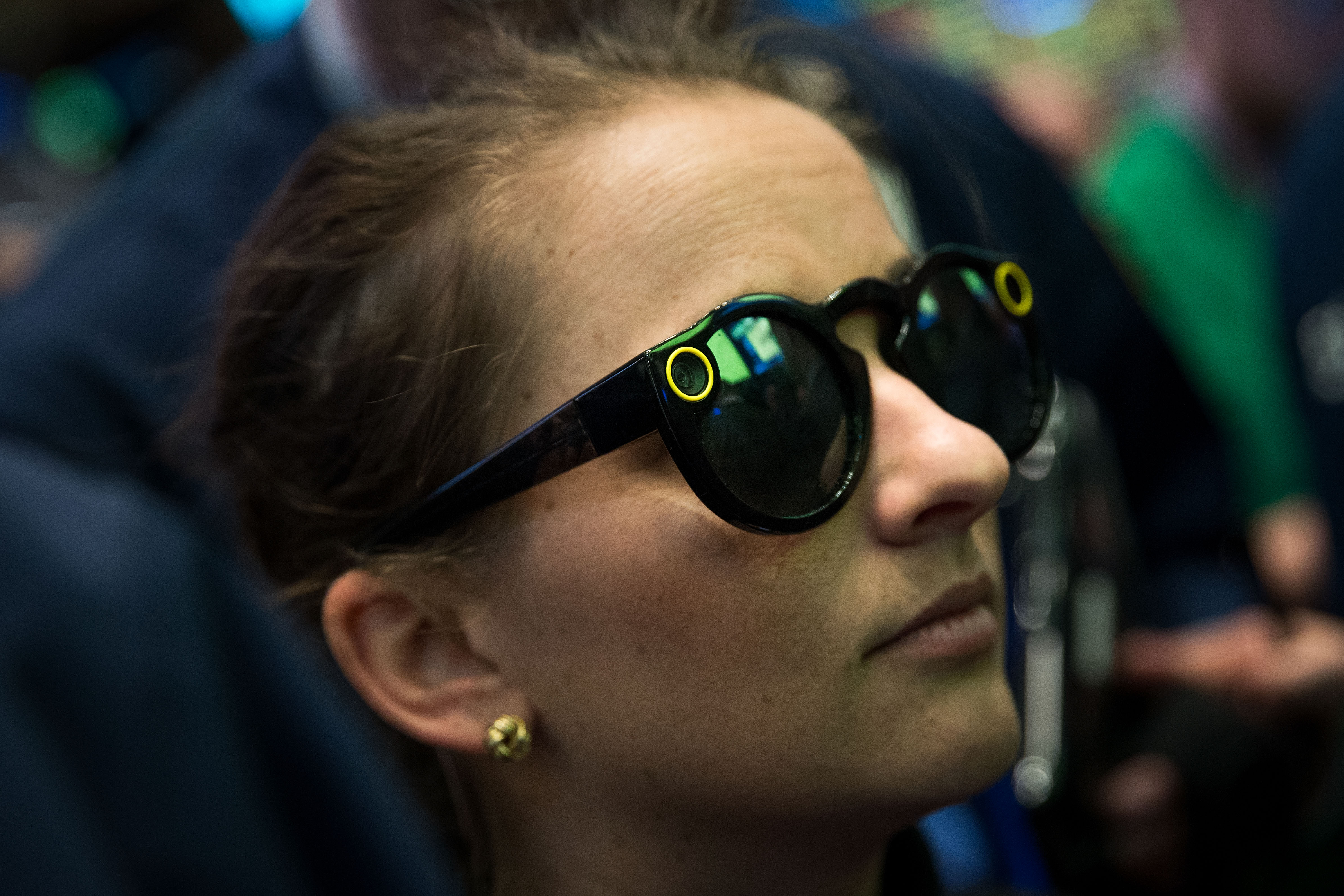 A woman wearing Snap Spectacles