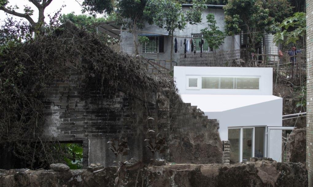 White house sitting on rocky hillside