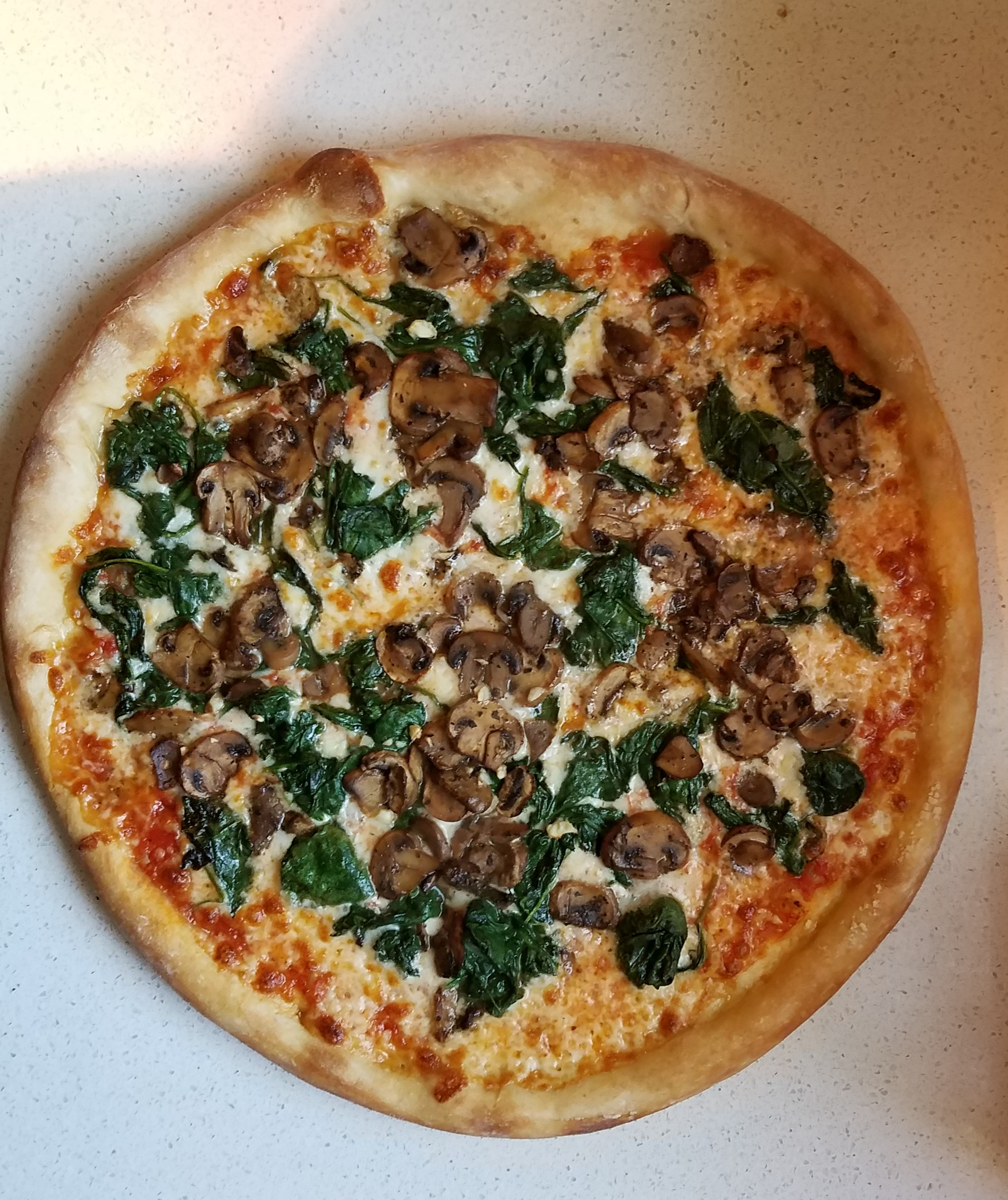 Spinach and mushroom pizza from Junior's