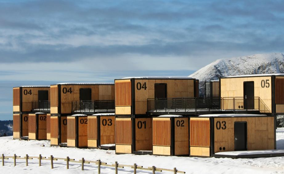 Wood shipping containers in snowy landscape