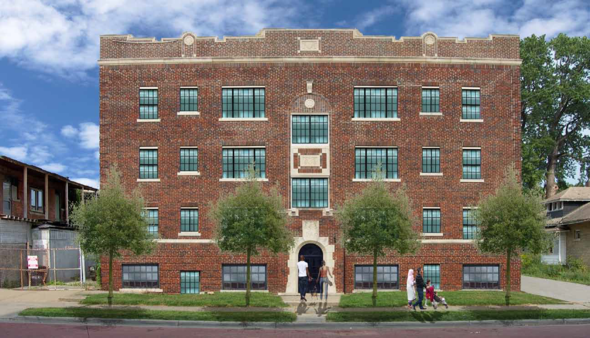 A large red brick building with multiple windows and trees in front of it. The building is part of Marlborough and IDAO buildings in Detroit.