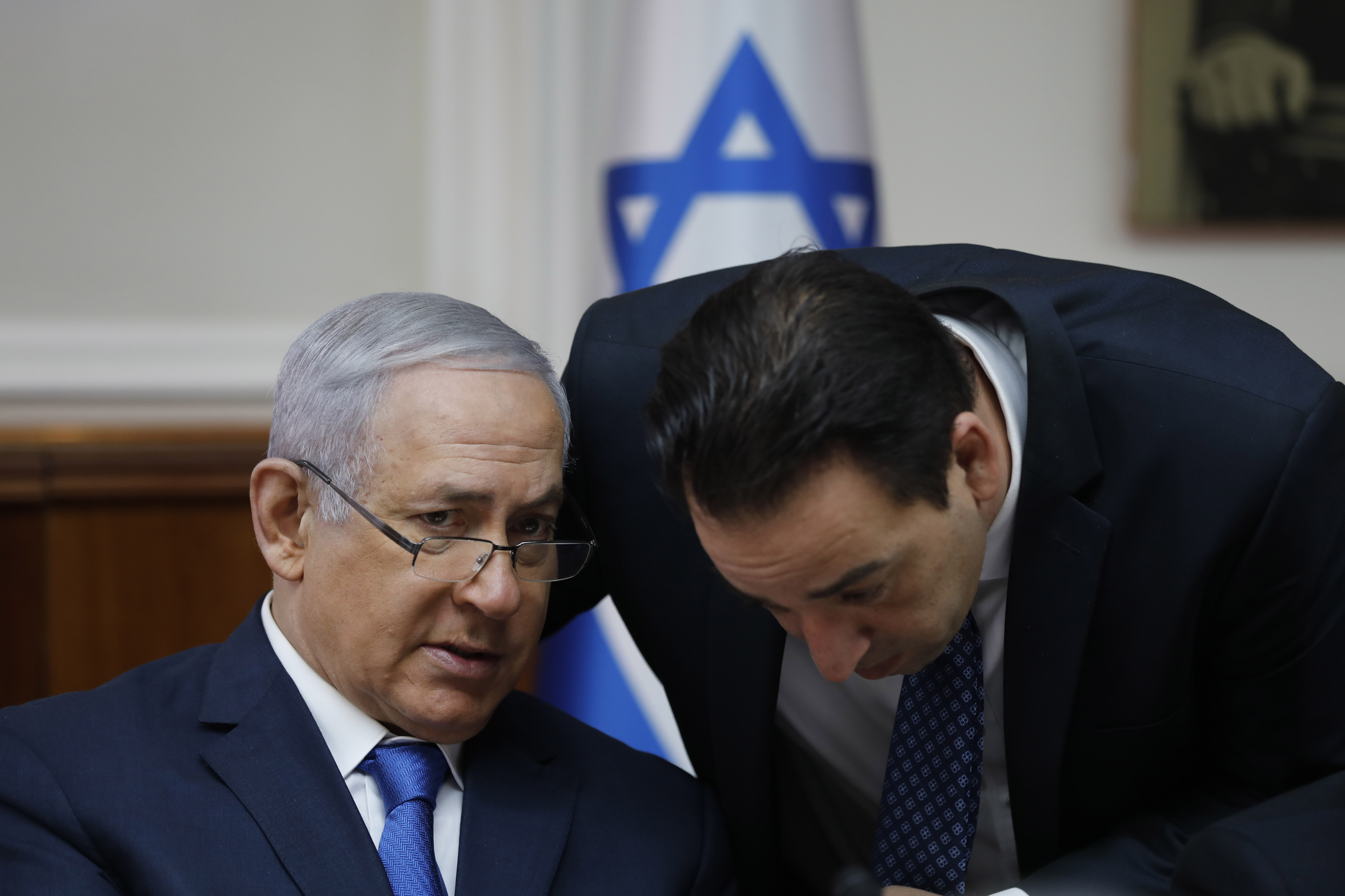 Israeli Prime Minister Benjamin Netanyahu (L) speaks with Ronen Peretz (R) during the weekly cabinet meeting at the Prime Minister's office in Jerusalem on December 16, 2018.
