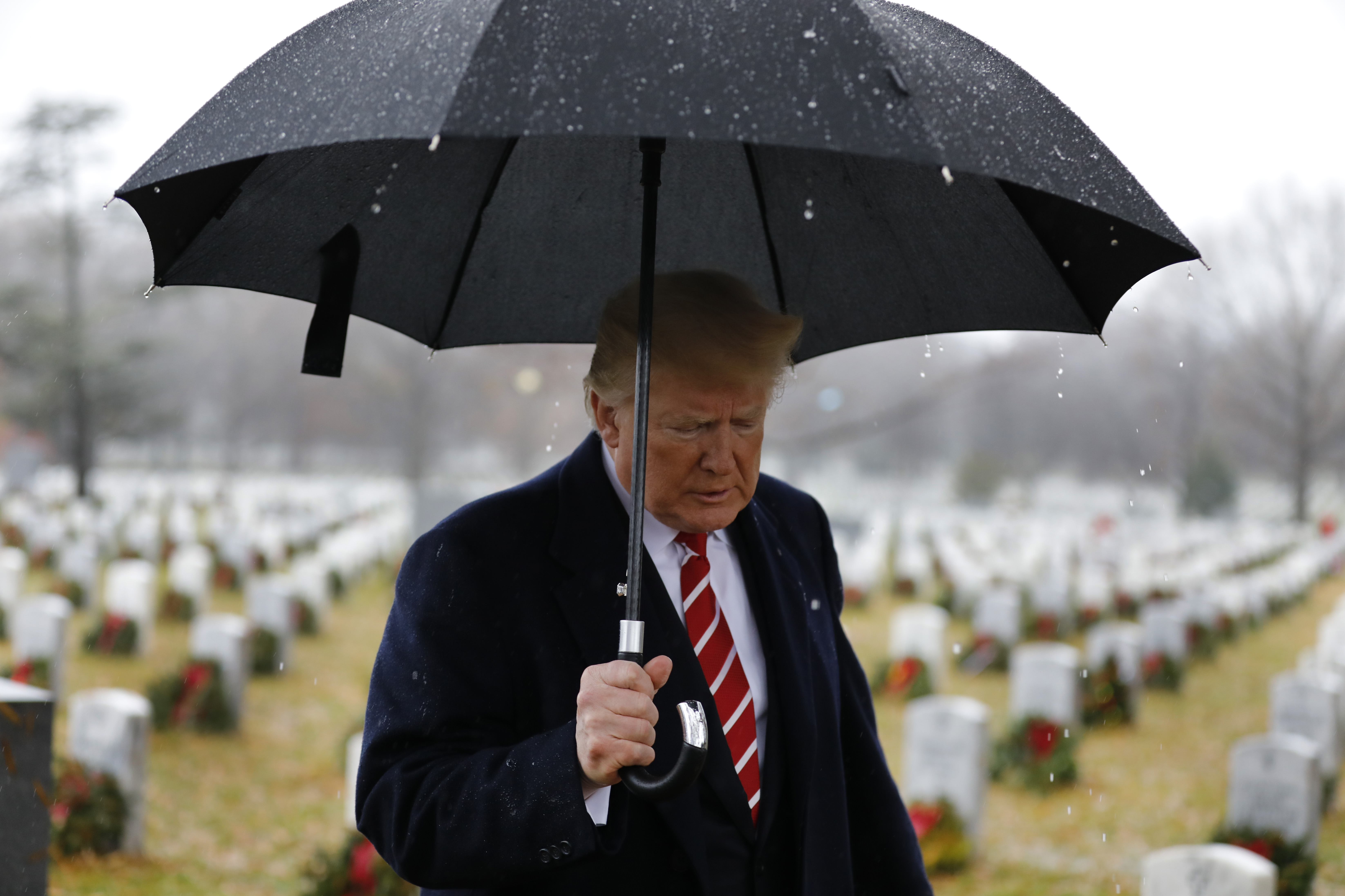 President Donald Trump visits Section 60 at Arlington National Cemetery on December 15, 2018 in Arlington, Virginia.