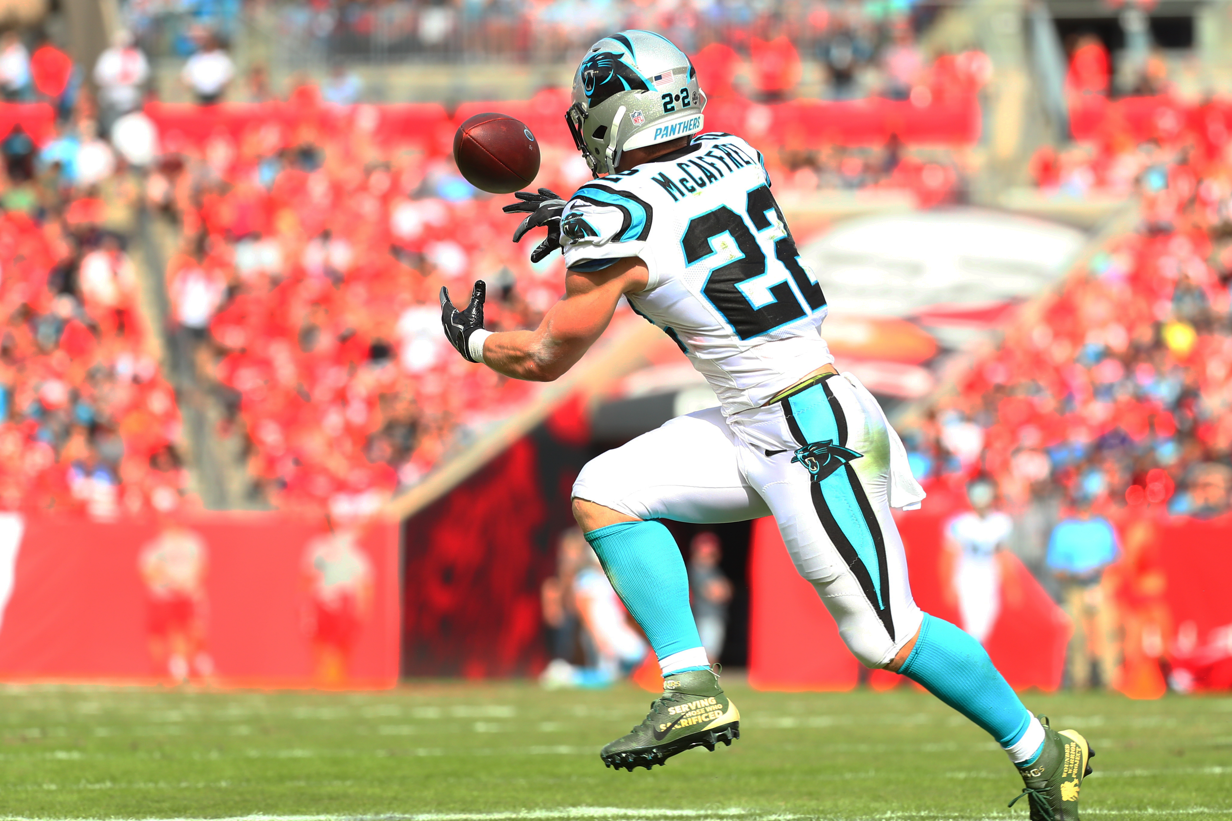 TAMPA, FLORIDA - DECEMBER 02: Christian McCaffrey #22 of the Carolina Panthers catches an eight-yard touchdown pass and run from Cam Newton (not pictured) during the first quarter against the Tampa Bay Buccaneers at Raymond James Stadium on December 02, 2