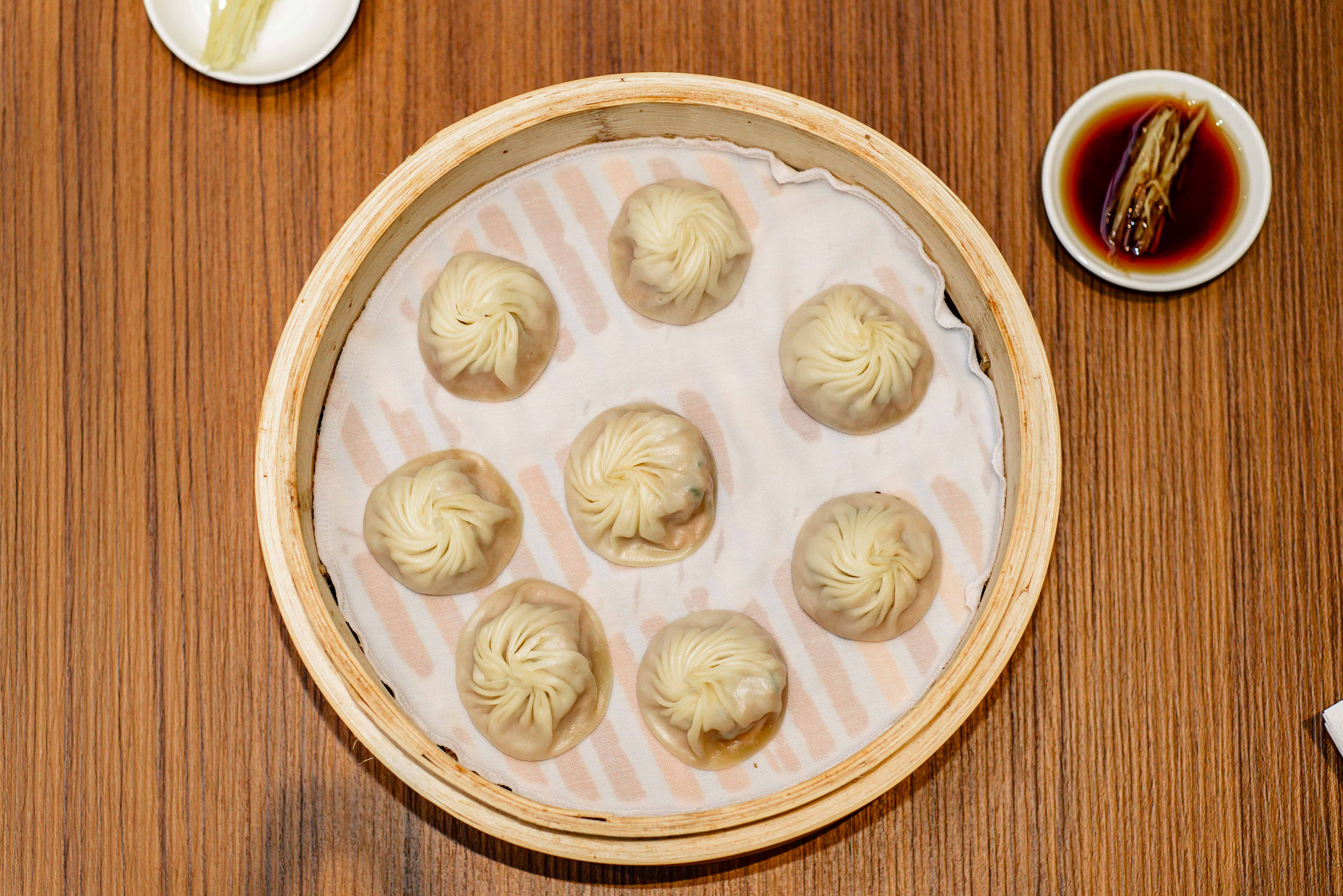 Xiaolongbao dumplings at Din Tai Fung's London Taiwanese dumpling restaurant now open in Covent Garden