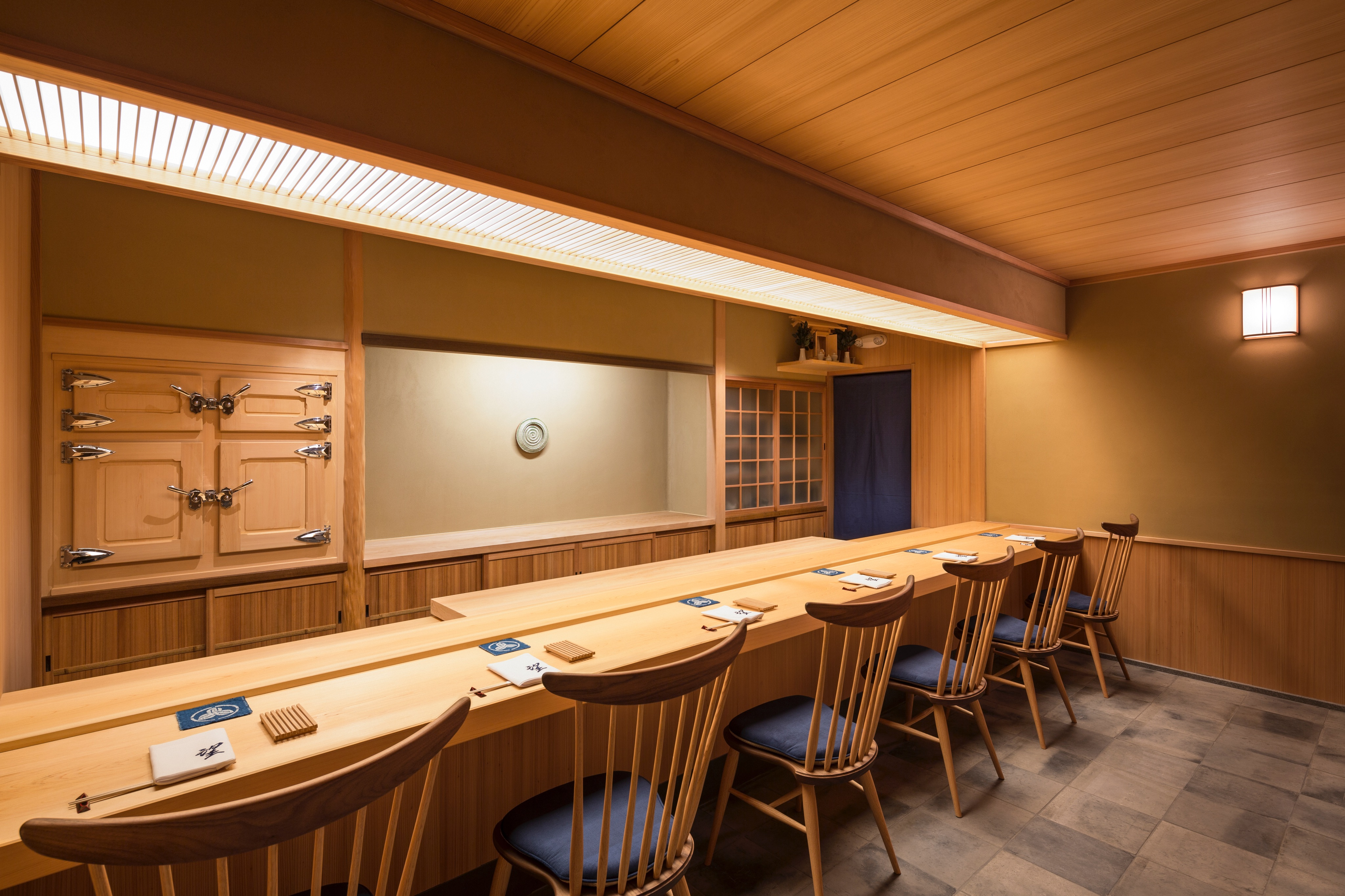A blonde wood-bedecked sushi bar with six seats