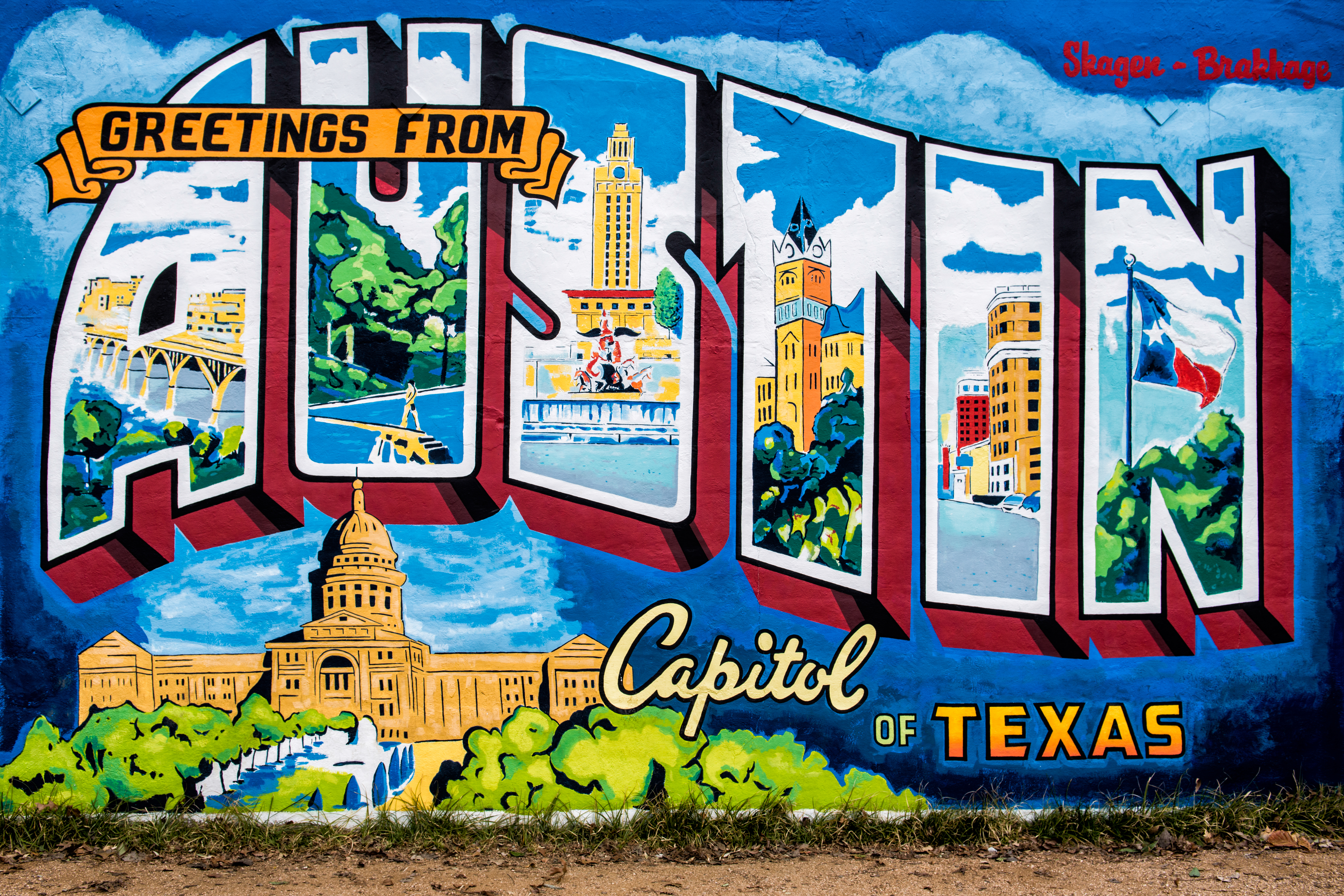 """Mural that looks like a postcard that says """"Greetings from Austin: Capitol of Texas"""""""