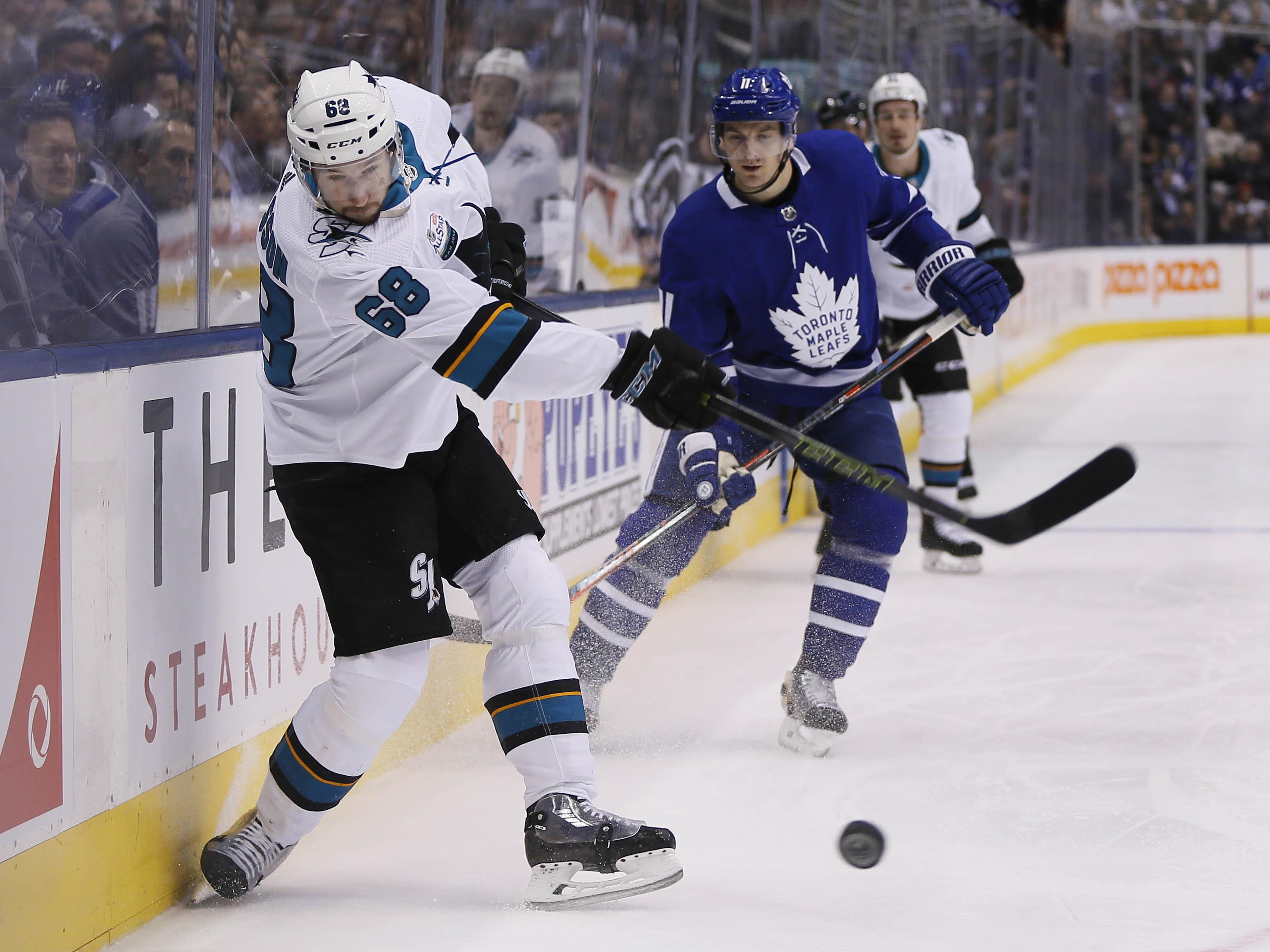 Nov 28, 2018; Toronto, Ontario, CAN; San Jose Sharks forward Melker Karlsson (68) shoots the puck as Toronto Maple Leafs forward Zach Hyman (11) looks on at Scotiabank Arena. Toronto defeated San Jose. Mandatory Credit: John E. Sokolowski