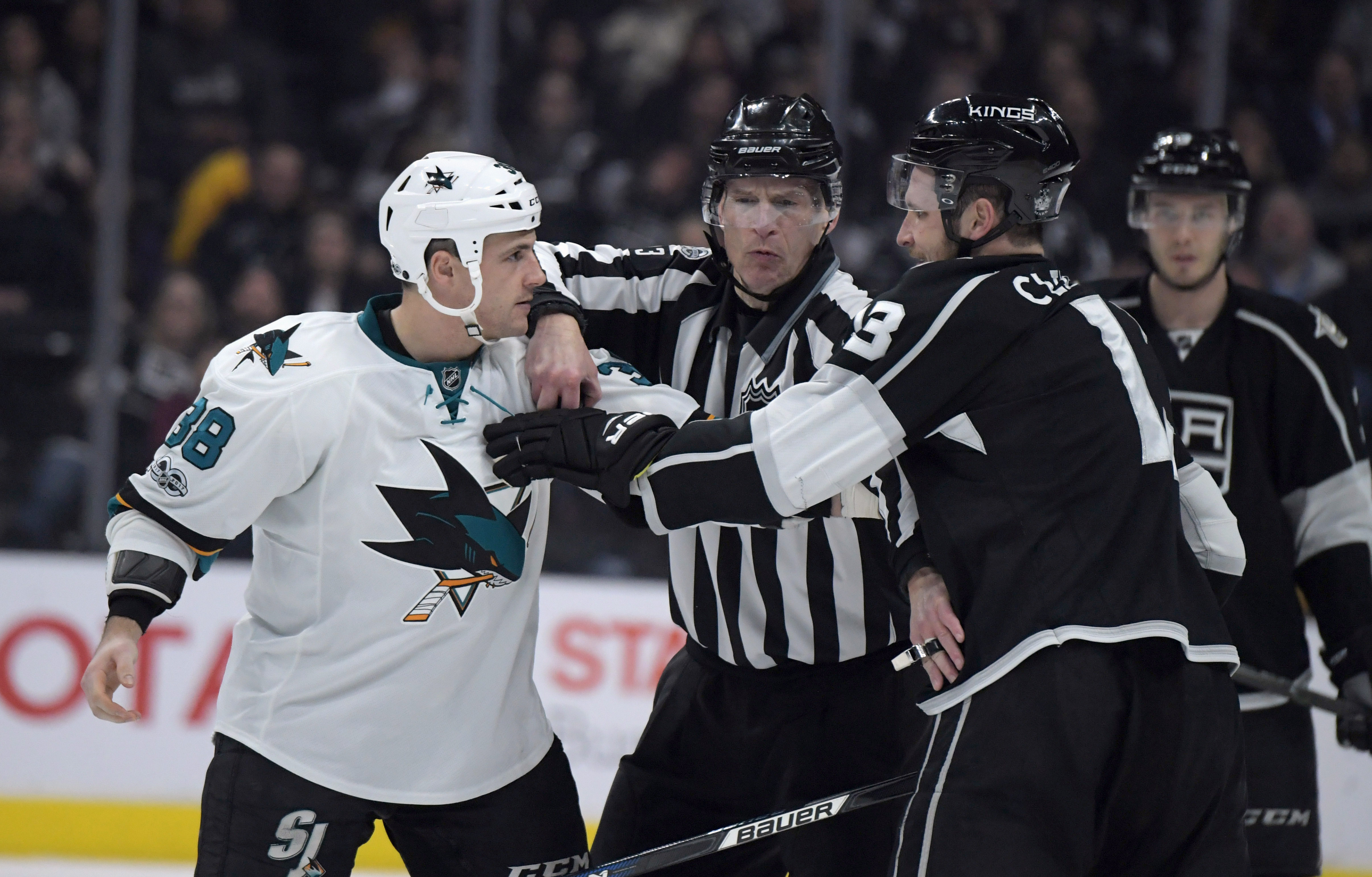 Jan 18, 2017; Los Angeles, CA, USA; San Jose Sharks center Micheal Haley (38) and Los Angeles Kings left wing Kyle Clifford (13) fight in the second period during a NHL hockey game at Staples Center.