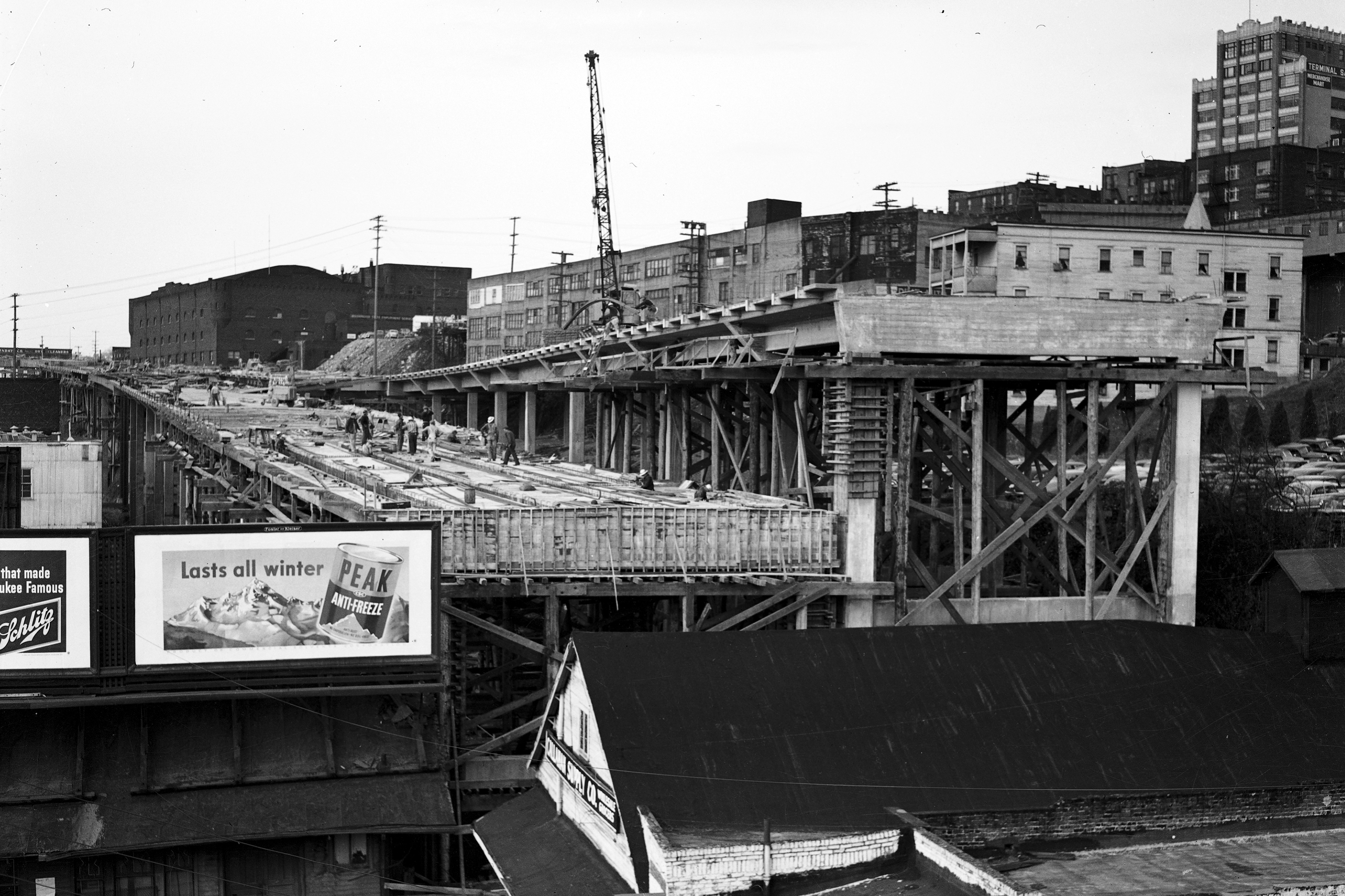 The Alaskan Way Viaduct and advertising billboards. This is a black and white photograph.