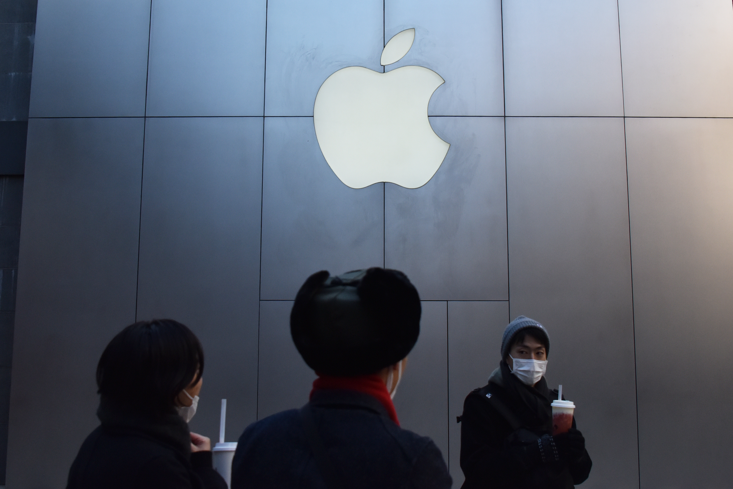 People walk past an Apple store in Beijing, China.