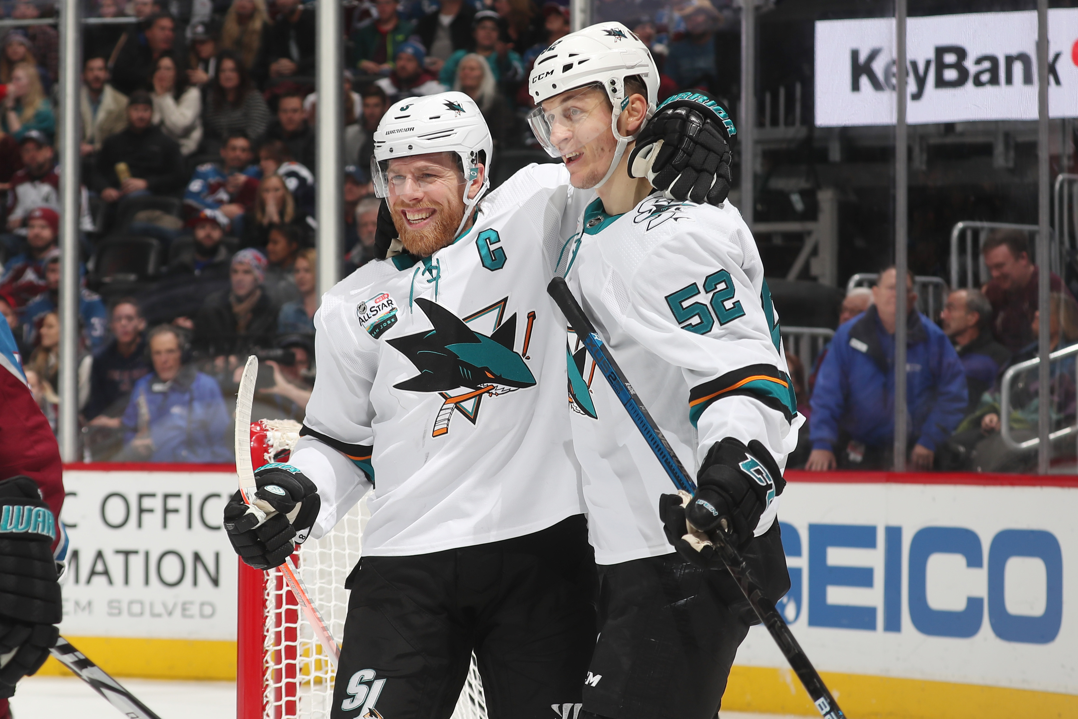 Lukas Radil #52 of the San Jose Sharks celebrates a goal against the Colorado Avalanche with teammate Joe Pavelski #8 at the Pepsi Center on January 2, 2019 in Denver, Colorado.