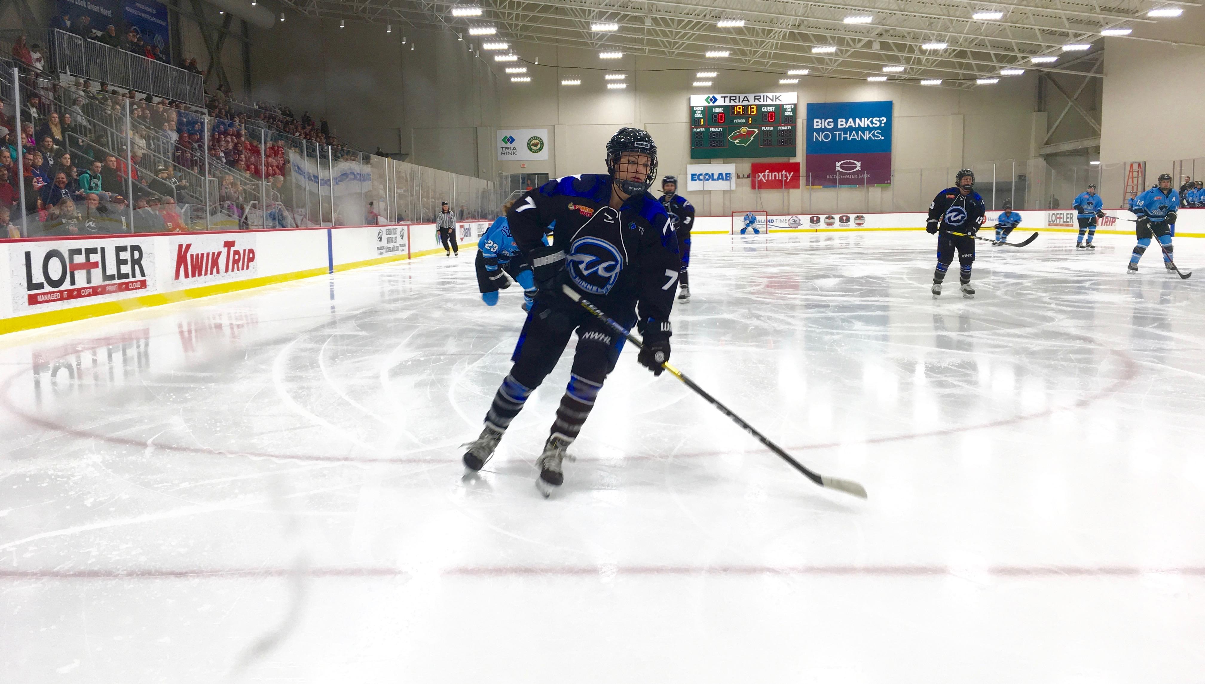 Emma Stauber (#7) skating for the Minnesota Whitecaps.