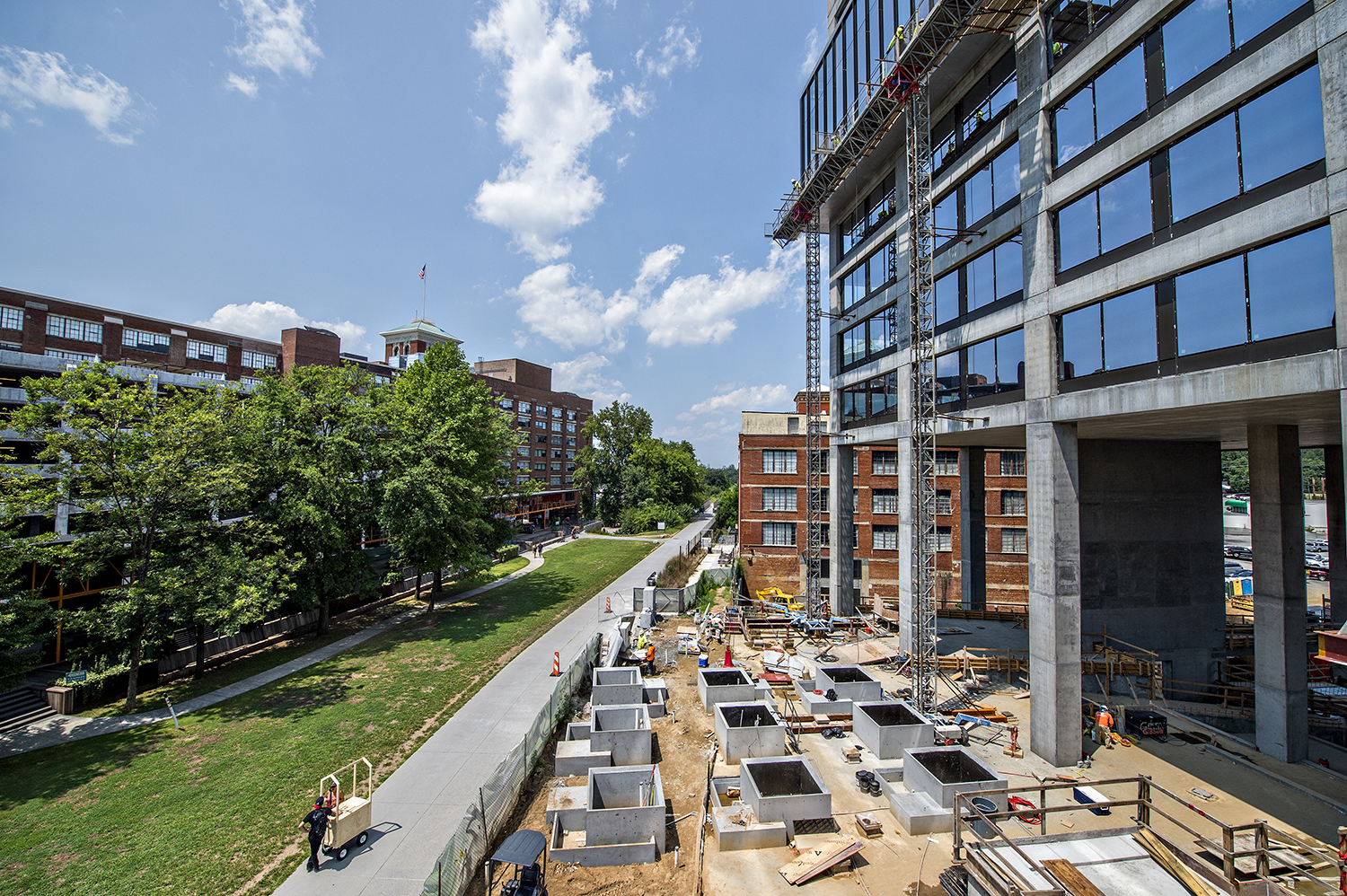 A photo of tree planters with attached benches and other public areas that will provide a respite for Beltline patrons at 725 Ponce, the trail's largest new office build to date.