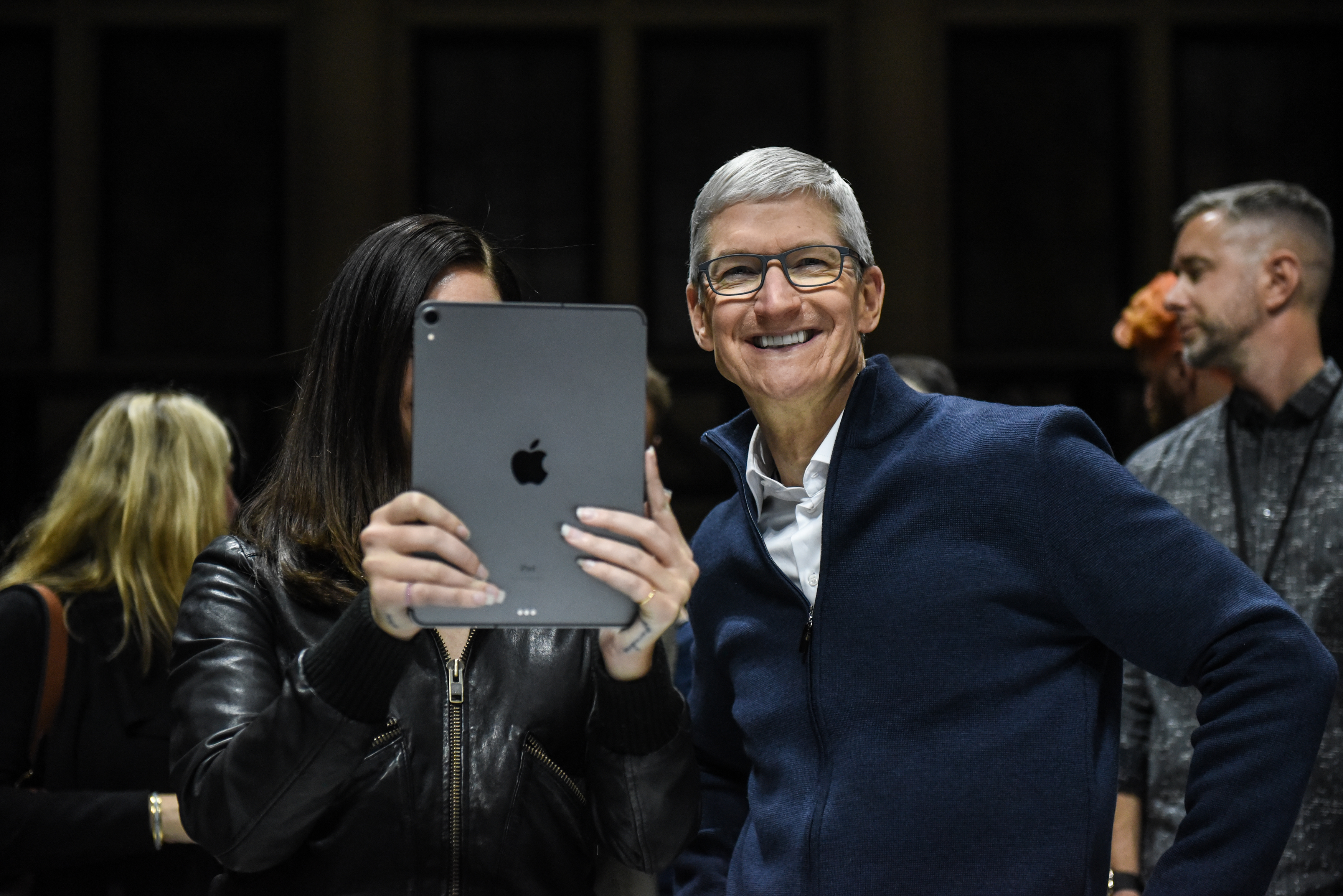 Tim Cook, CEO of Apple laughs while Lana Del Rey (with iPad) takes a photo.