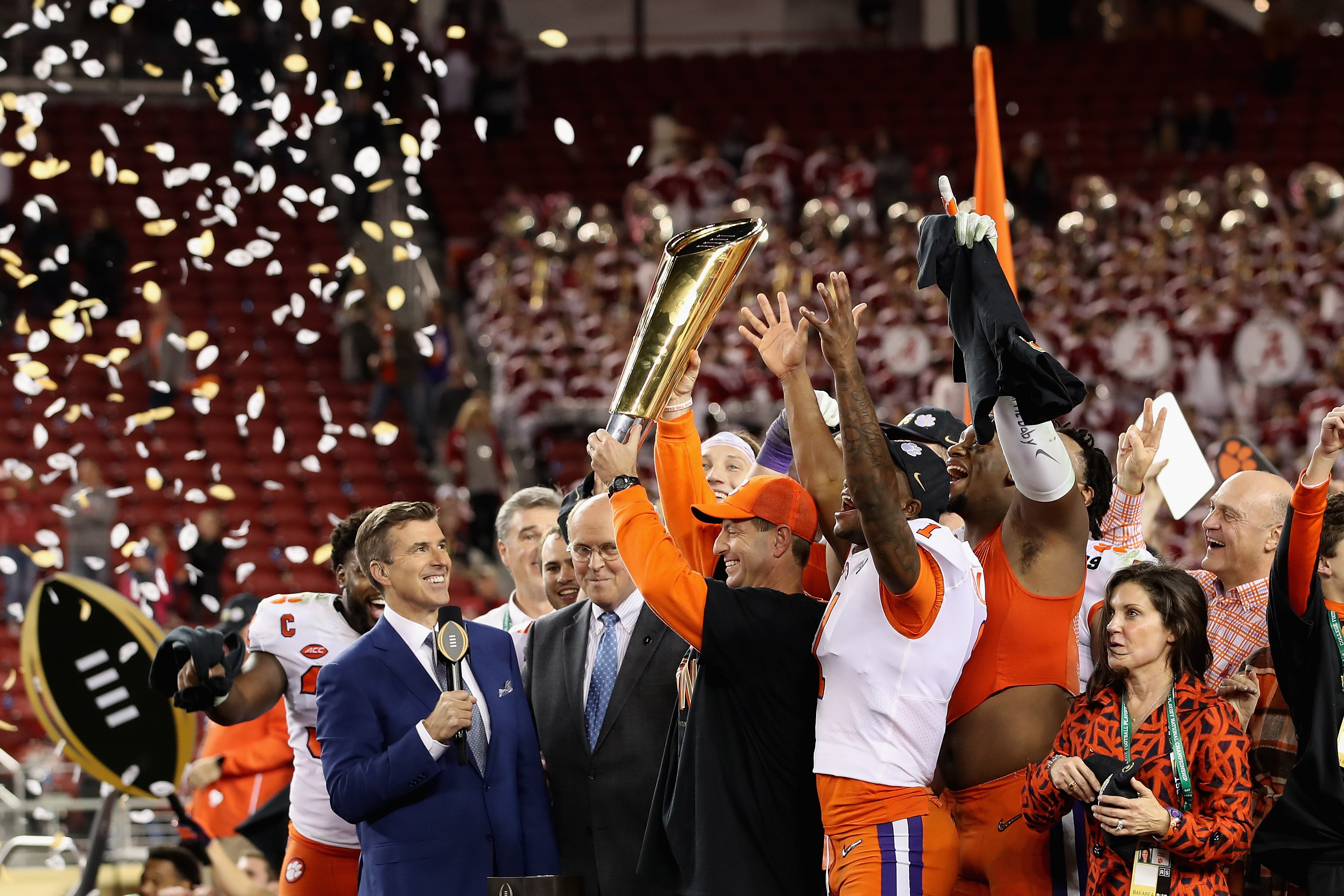 Clemson Tigers head coach Dabo Swinney and the team celebrate with the national championship trophy