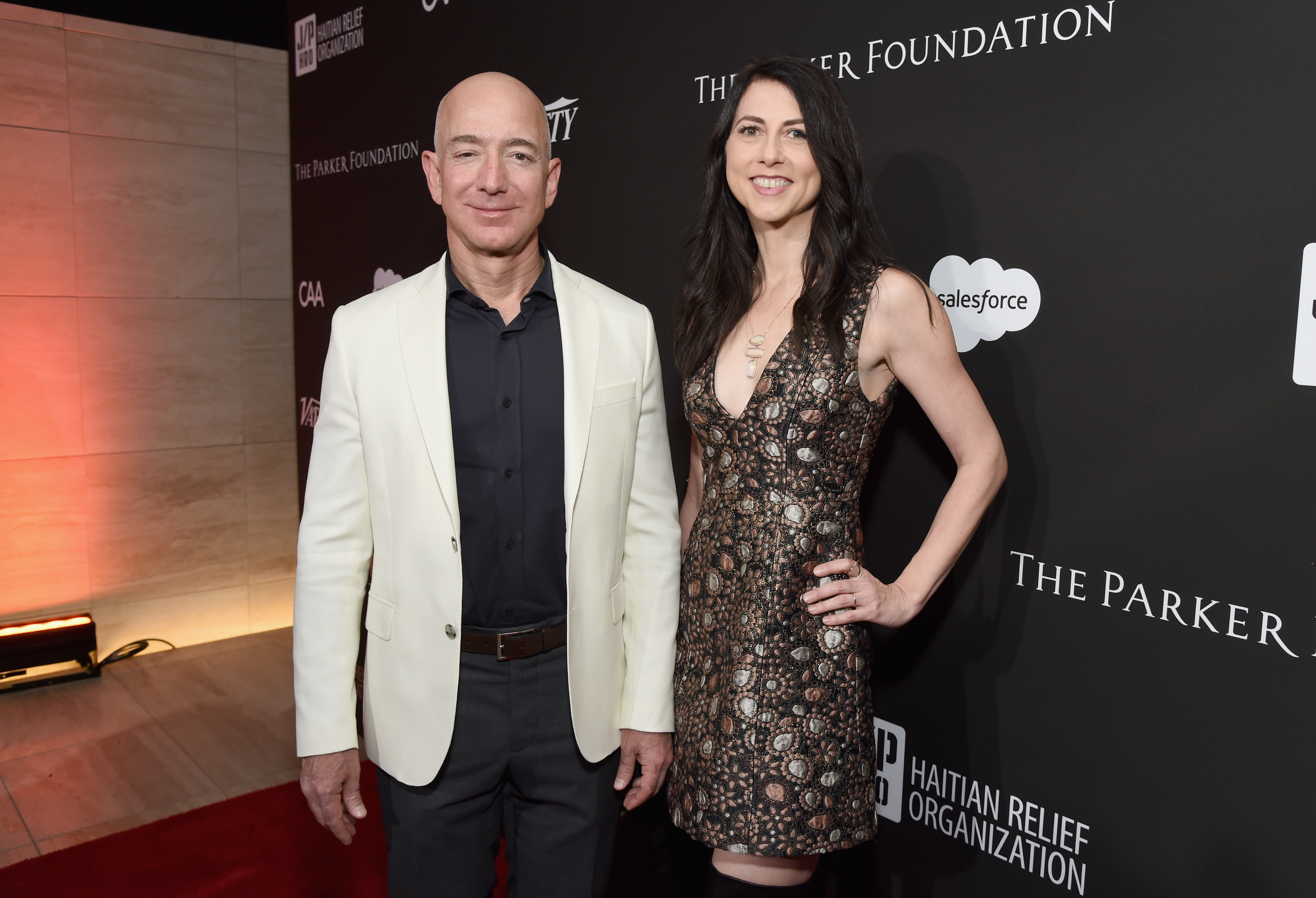 Amazon CEO Jeff Bezos and wife MacKenzie pose at the Sean Penn & Friends HAITI RISING Gala in 2018.