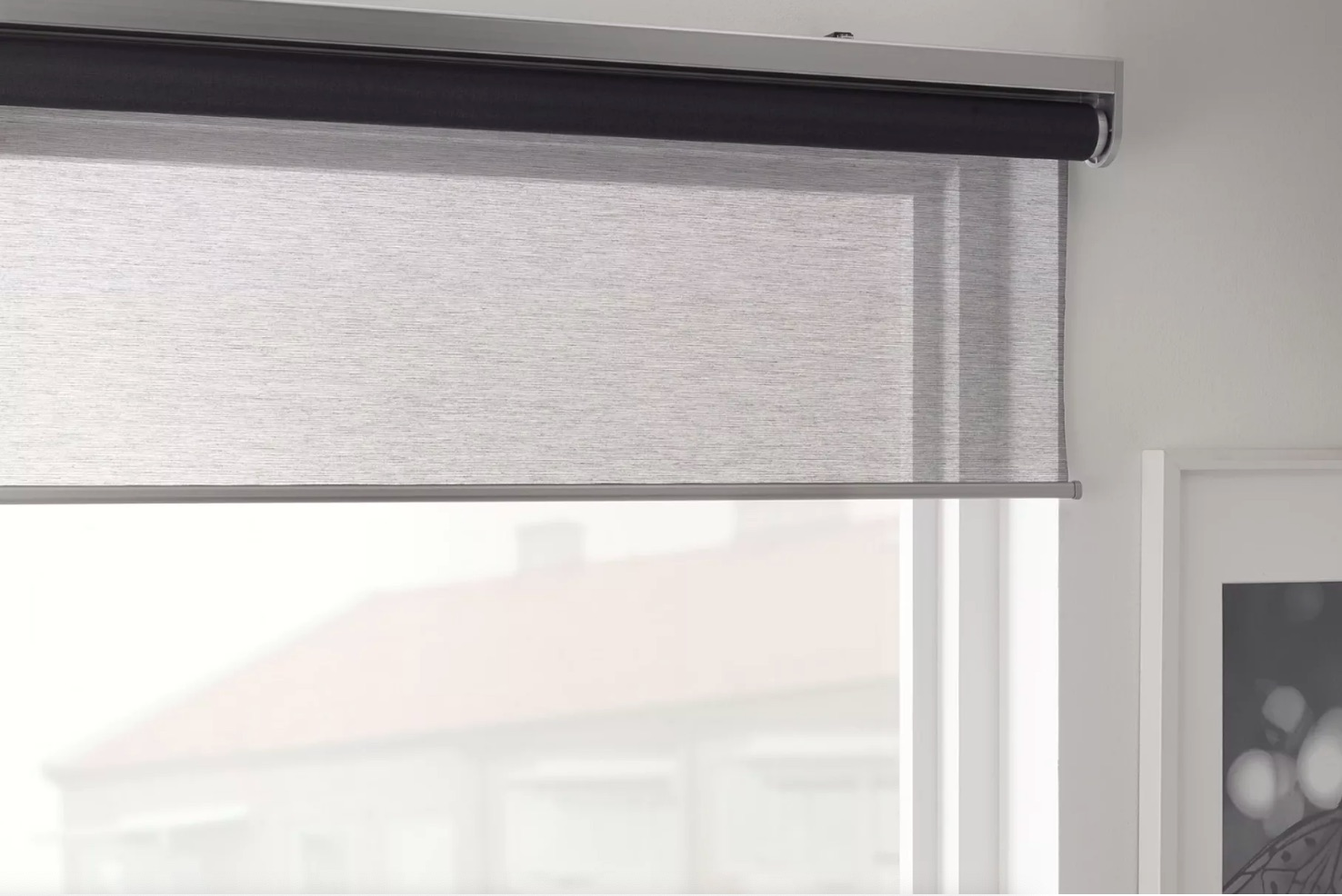 Light gray blinds hanging in window