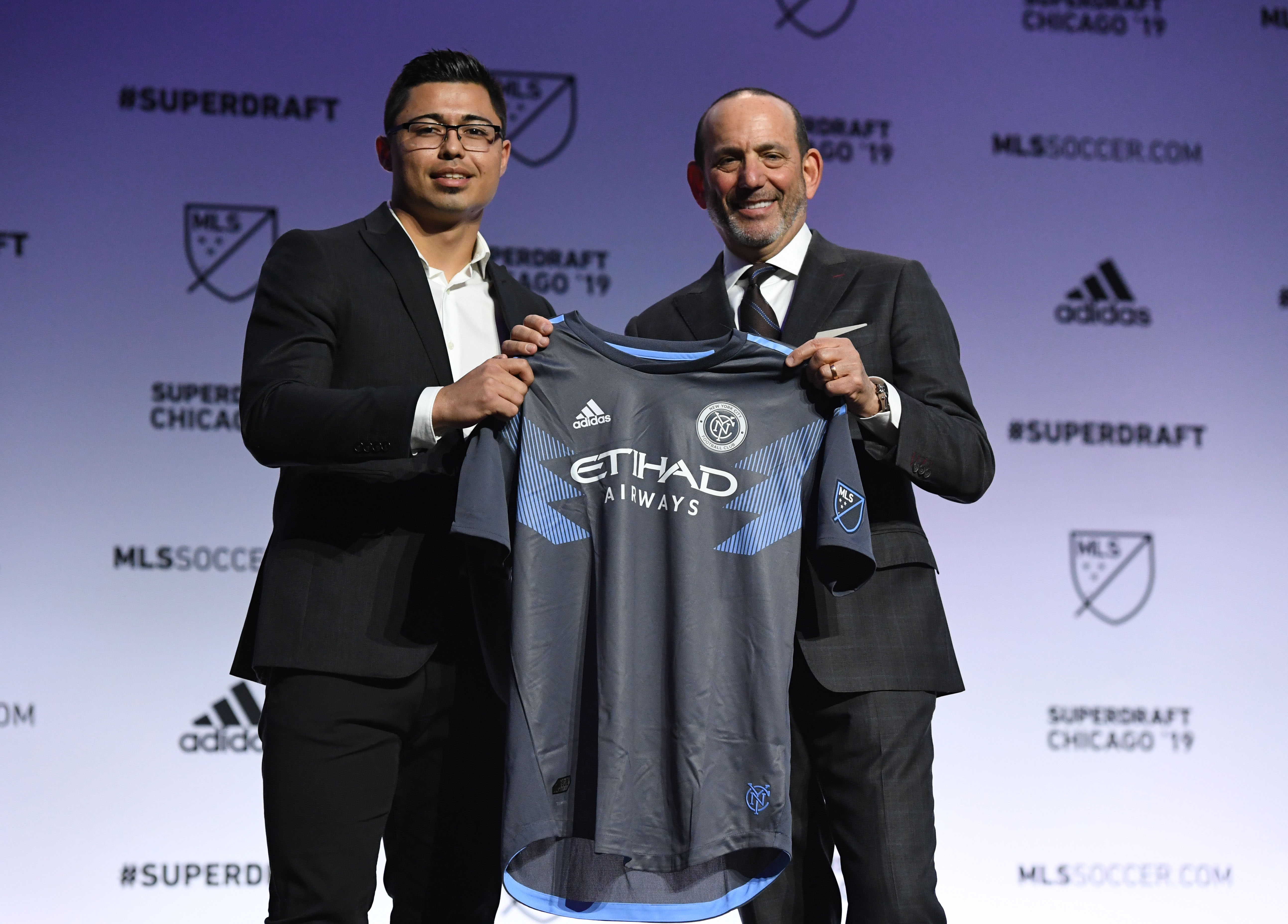 Luis Barraza greets MLS commissioner Don Garber after being selected as the number twelve overall pick to New York City FC in the first round of the 2019 MLS Super Draft