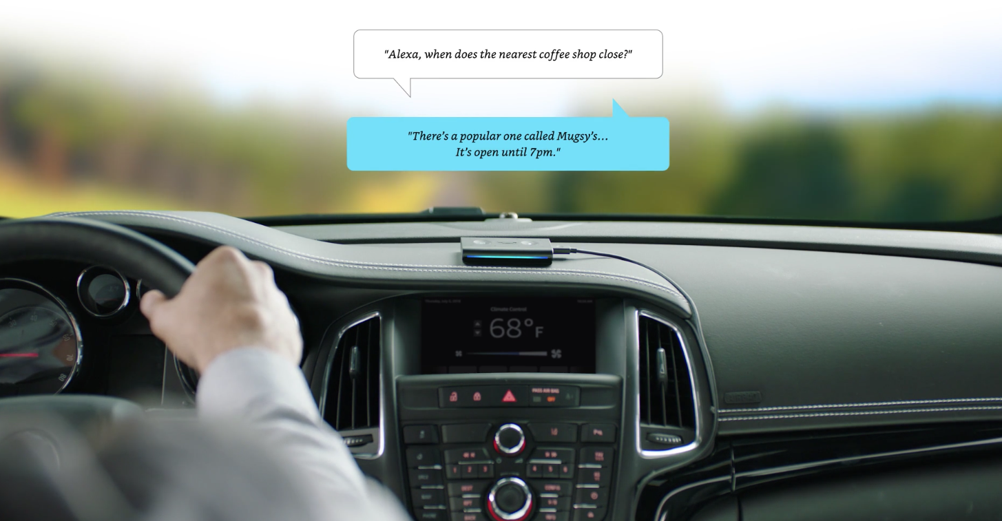 """A dashboard of a car with a voice assistant. The talking bubbles read, """"Alexa, when does the nearest coffee shop close?"""" """"There's a popular one called Mugsy's...It's open till 7 pm."""""""