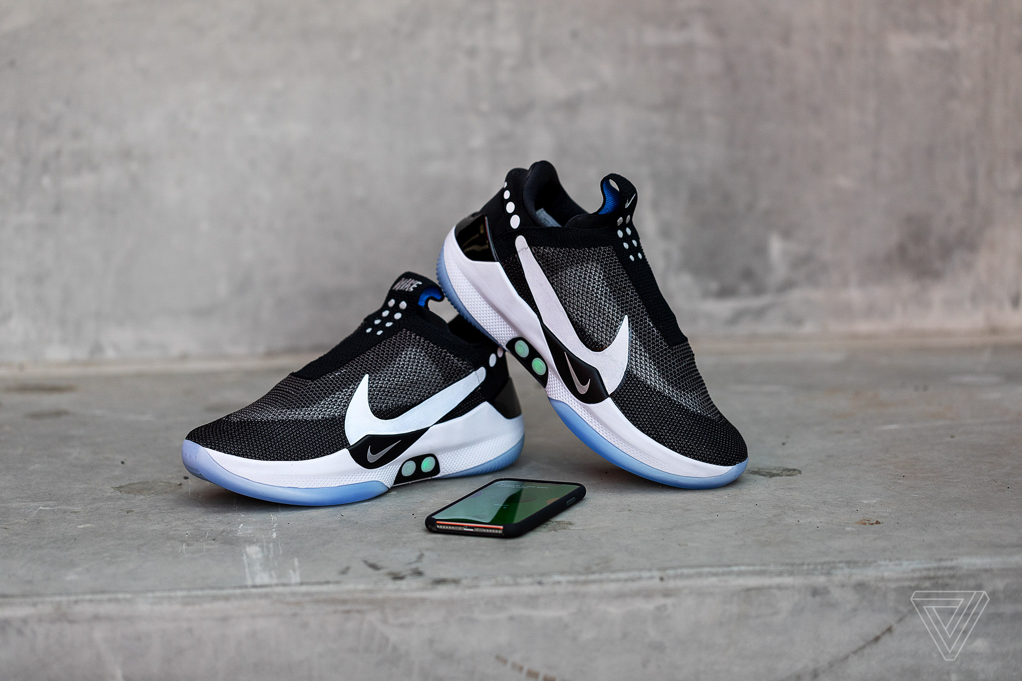 Nike s Adapt BB self-lacing sneakers let you tie your shoes from an ... 869ff4604a