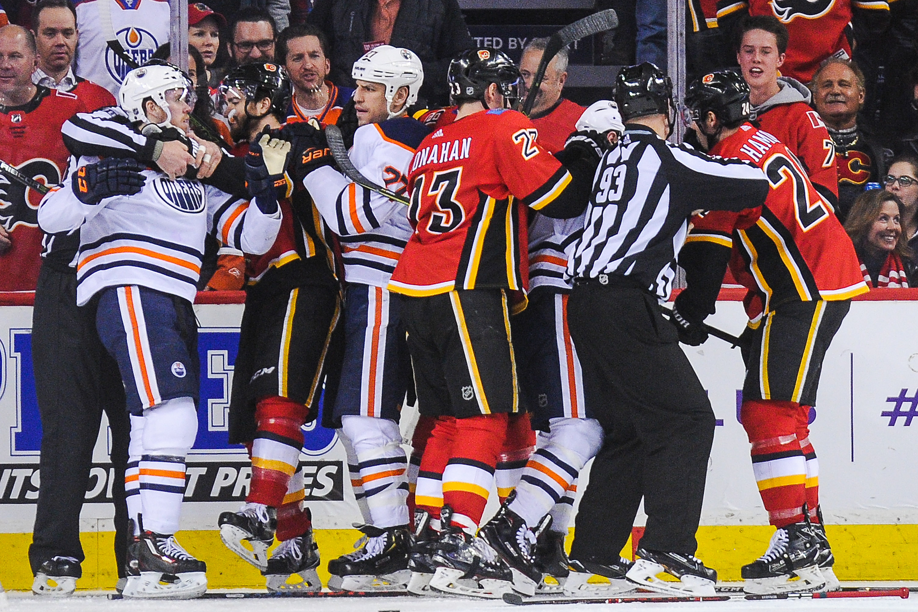 CALGARY, AB - MARCH 13: The Calgary Flames mix it up after the whistle with the Edmonton Oilers during an NHL game at Scotiabank Saddledome on March 13, 2018 in Calgary, Alberta, Canada.