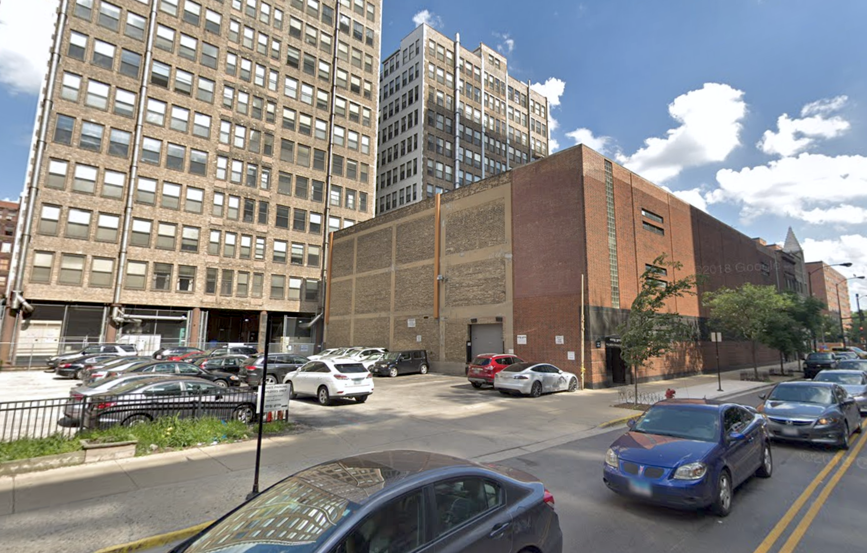 Glassy 29-story apartment tower looks to make a splash along Printer's Row