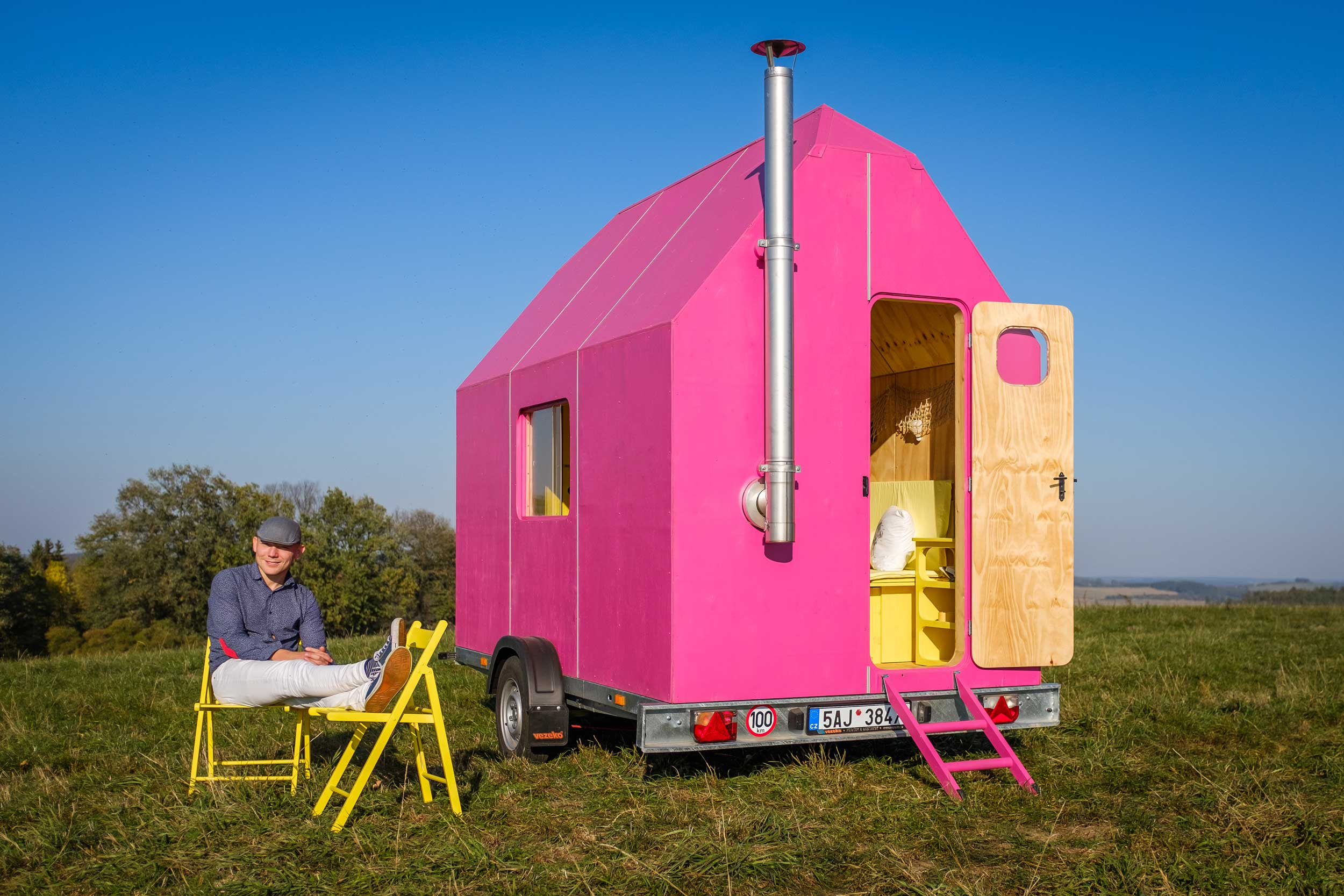 Bright pink small home in field