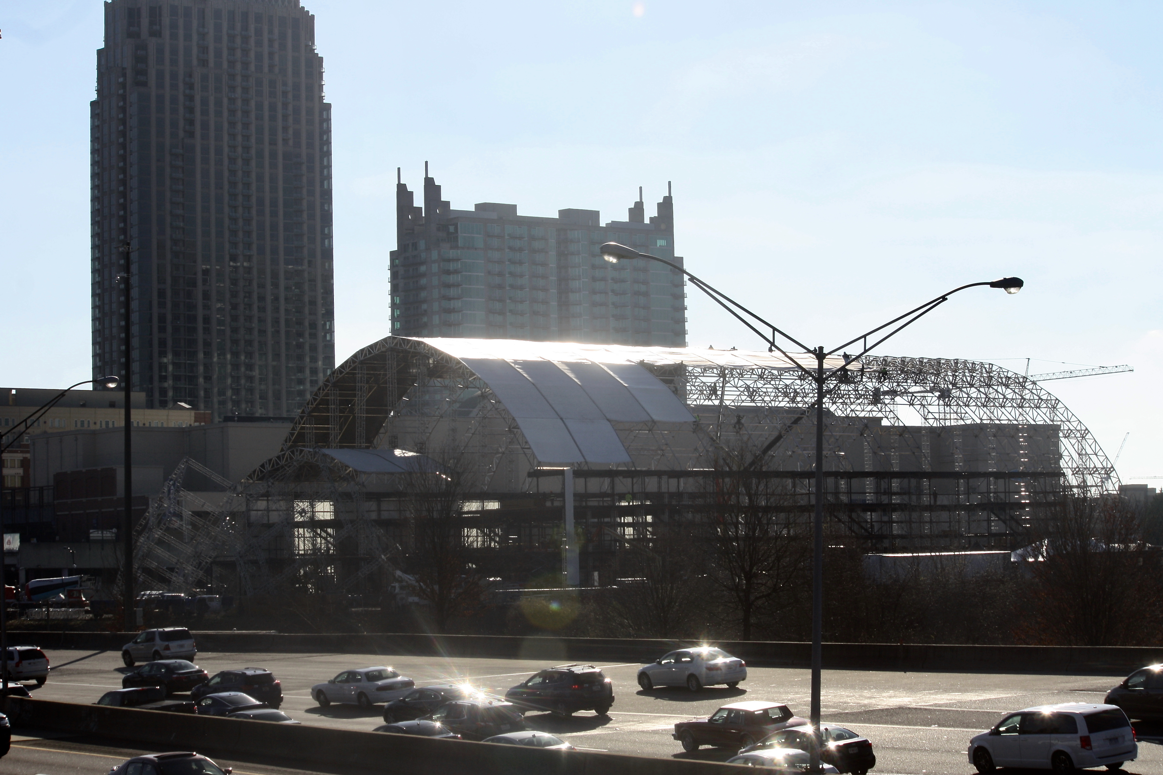 A photo of the 100-foot-tall, temporary venue being pieced together Tuesday, as seen from across the Connector in Midtown.