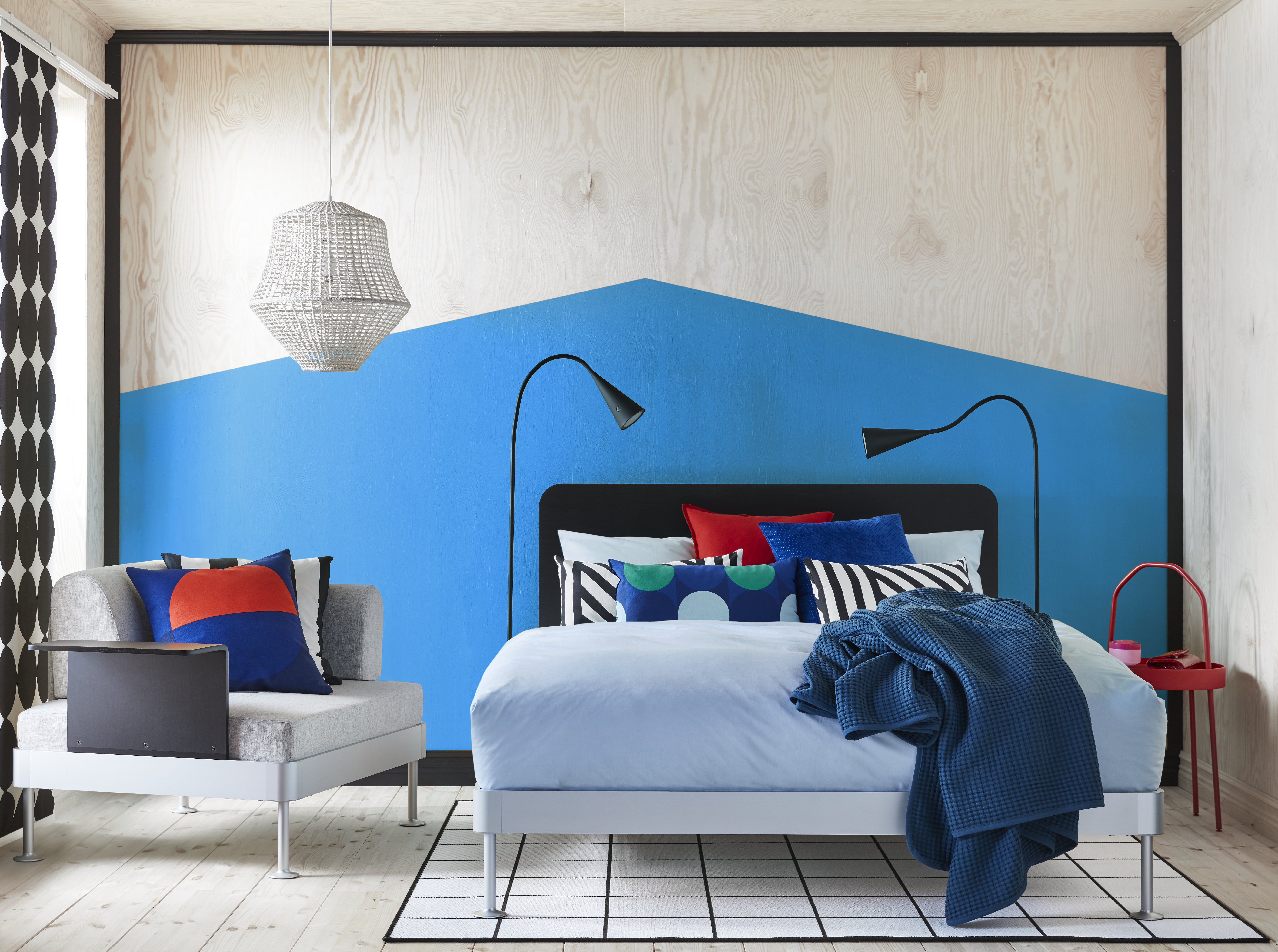Platform bed with colorful pillows