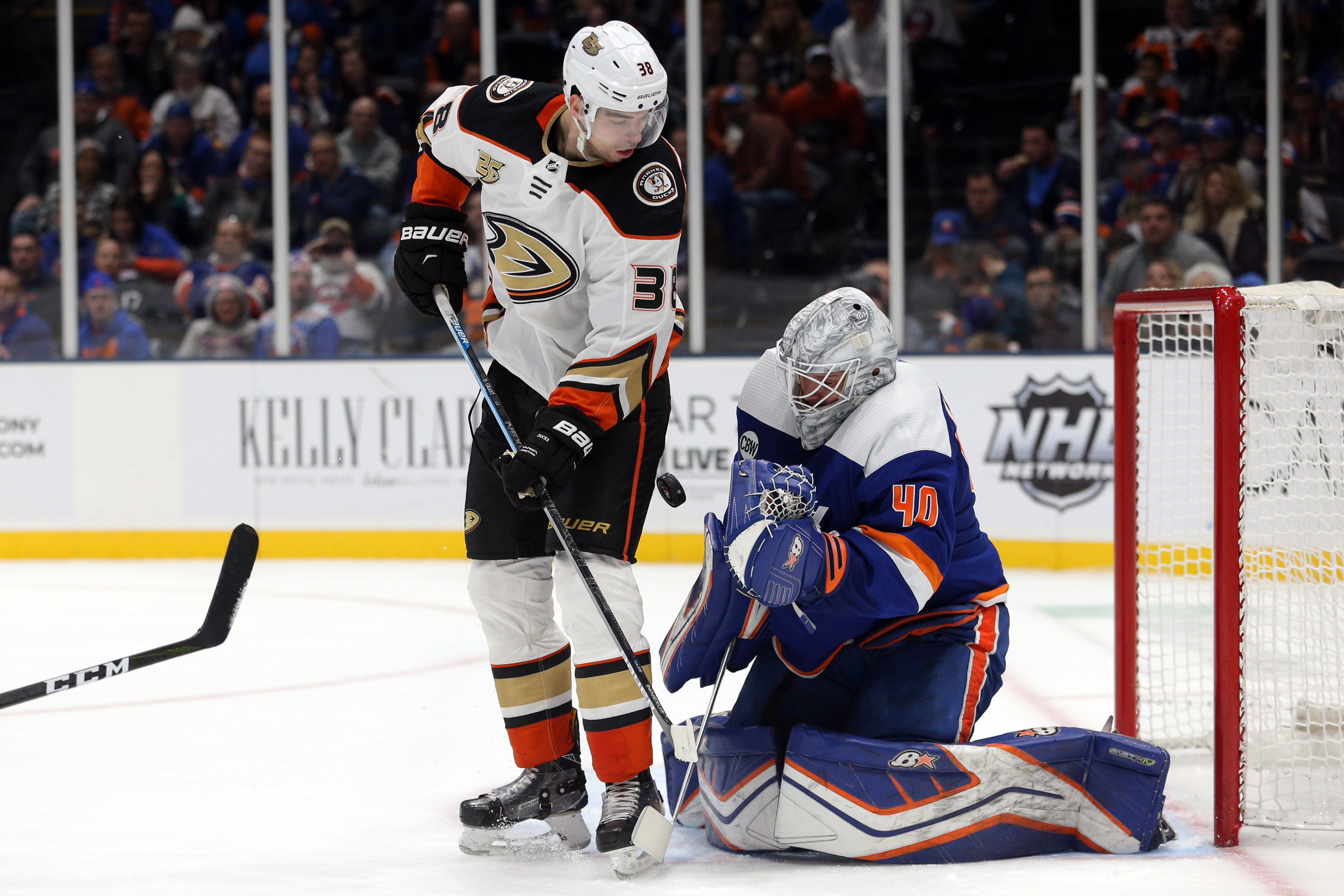 Jan 20, 2019; Uniondale, NY, USA; New York Islanders goalie Robin Lehner (40) makes a save against Anaheim Ducks center Derek Grant (38) during the third period at Nassau Veterans Memorial Coliseum.